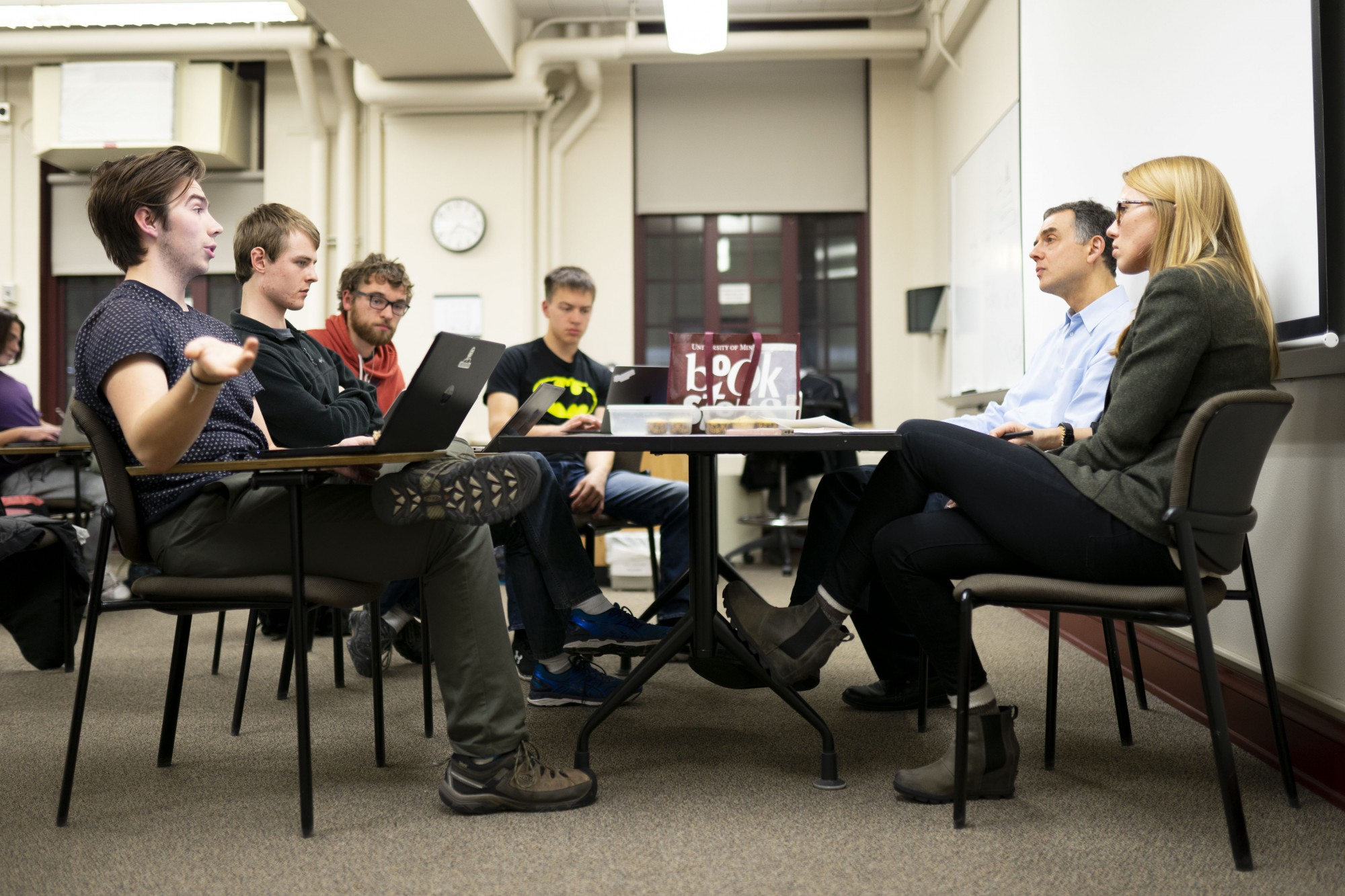 Professor Ellan Tadmor, who sits back right, listens to students present their findings to the class science court on Tuesday, Nov. 5.