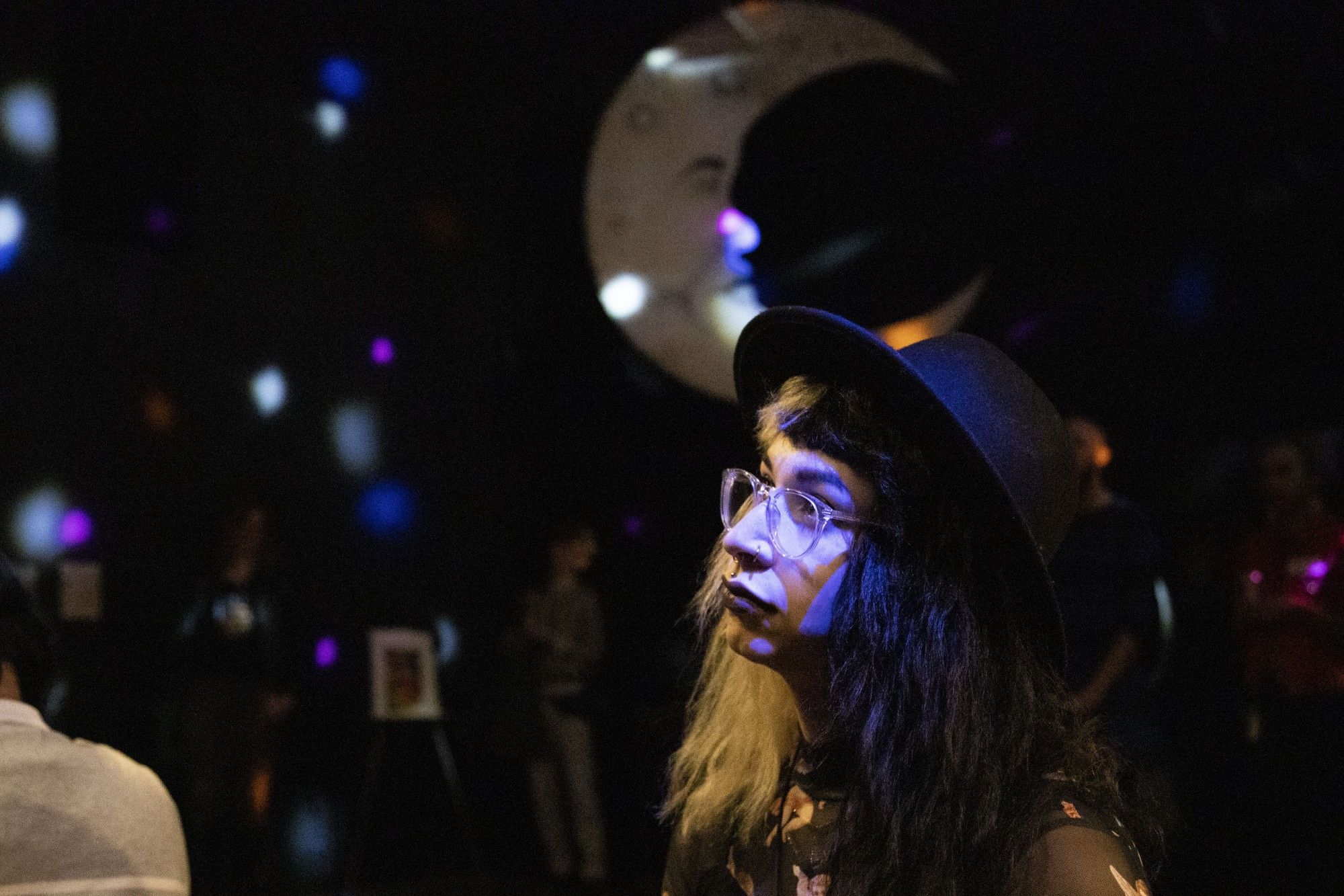 Rose Hein watches a performance at Malleable, an art exhibition by and for trans women and trans femme artists, in Minneapolis on Thursday, Nov. 7.