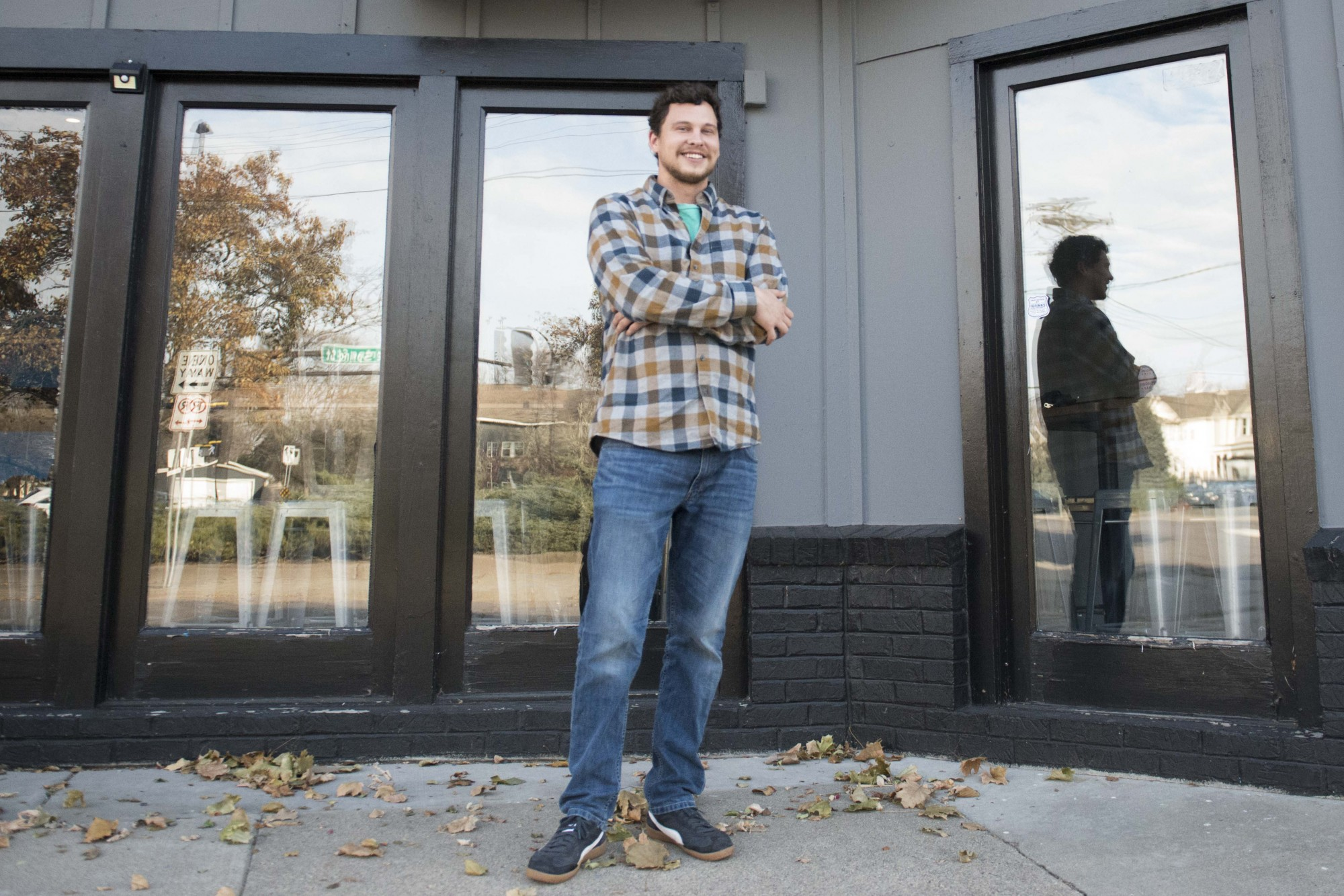 Alex Zick, owner of the new NE-Arcade in Northeast Minneapolis, poses for a portrait outside the bar and arcade on Saturday, Nov. 16. It opens to the public on Friday.
