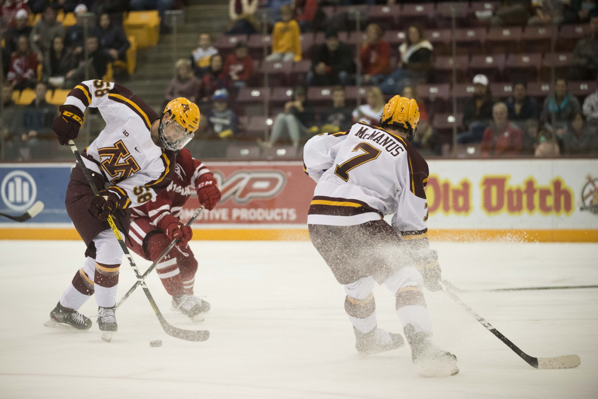 Forward Sampo Ranta fights for the puck during the game against the Wisconsin Badgers at 3M Arena at Mariucci on Friday, Nov. 22. The Gophers won 4-1.