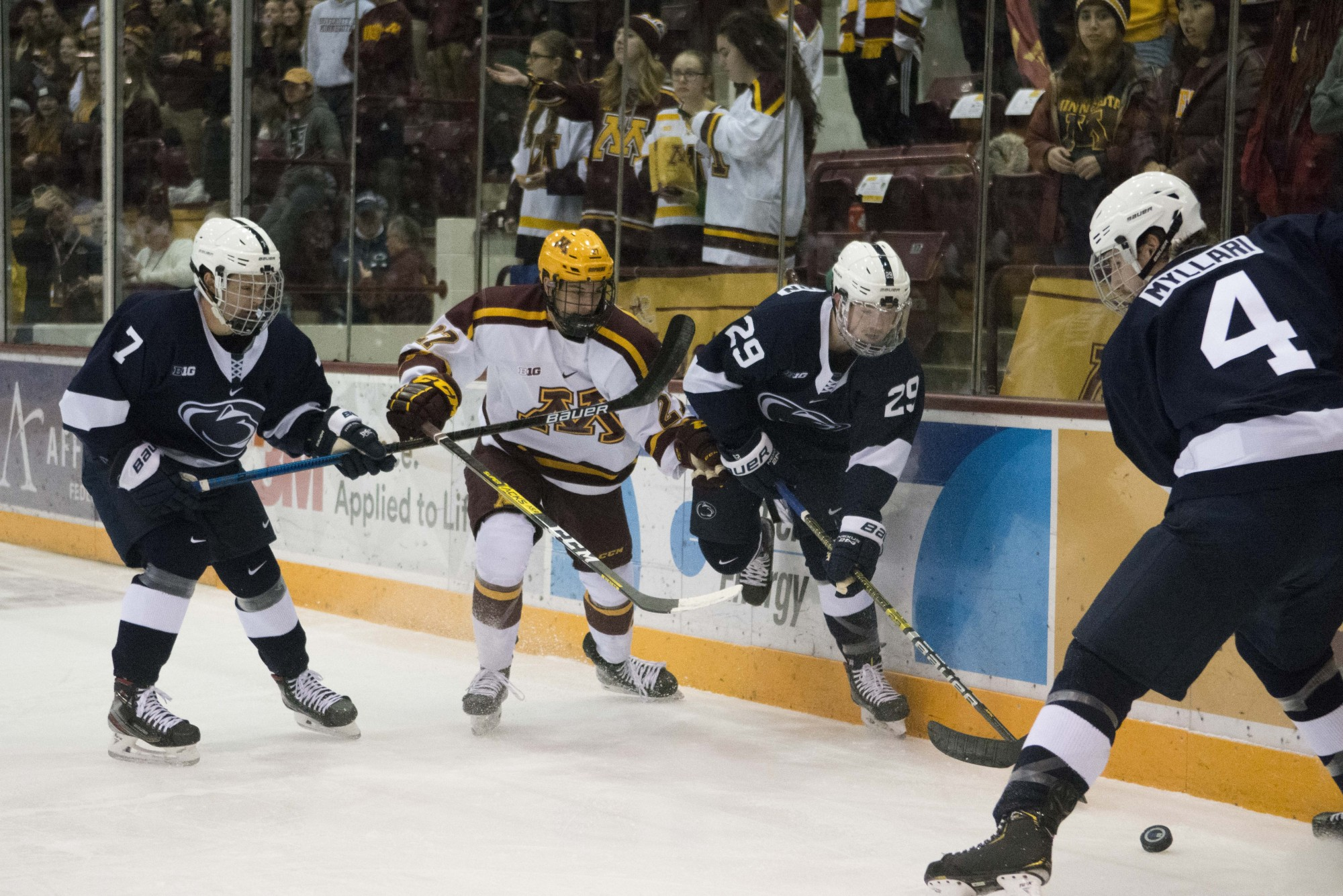 Forward Blake McLaughlin chases after the puck during the game against the Penn State at 3M Arena at Mariucci on Friday, Nov. 15.
