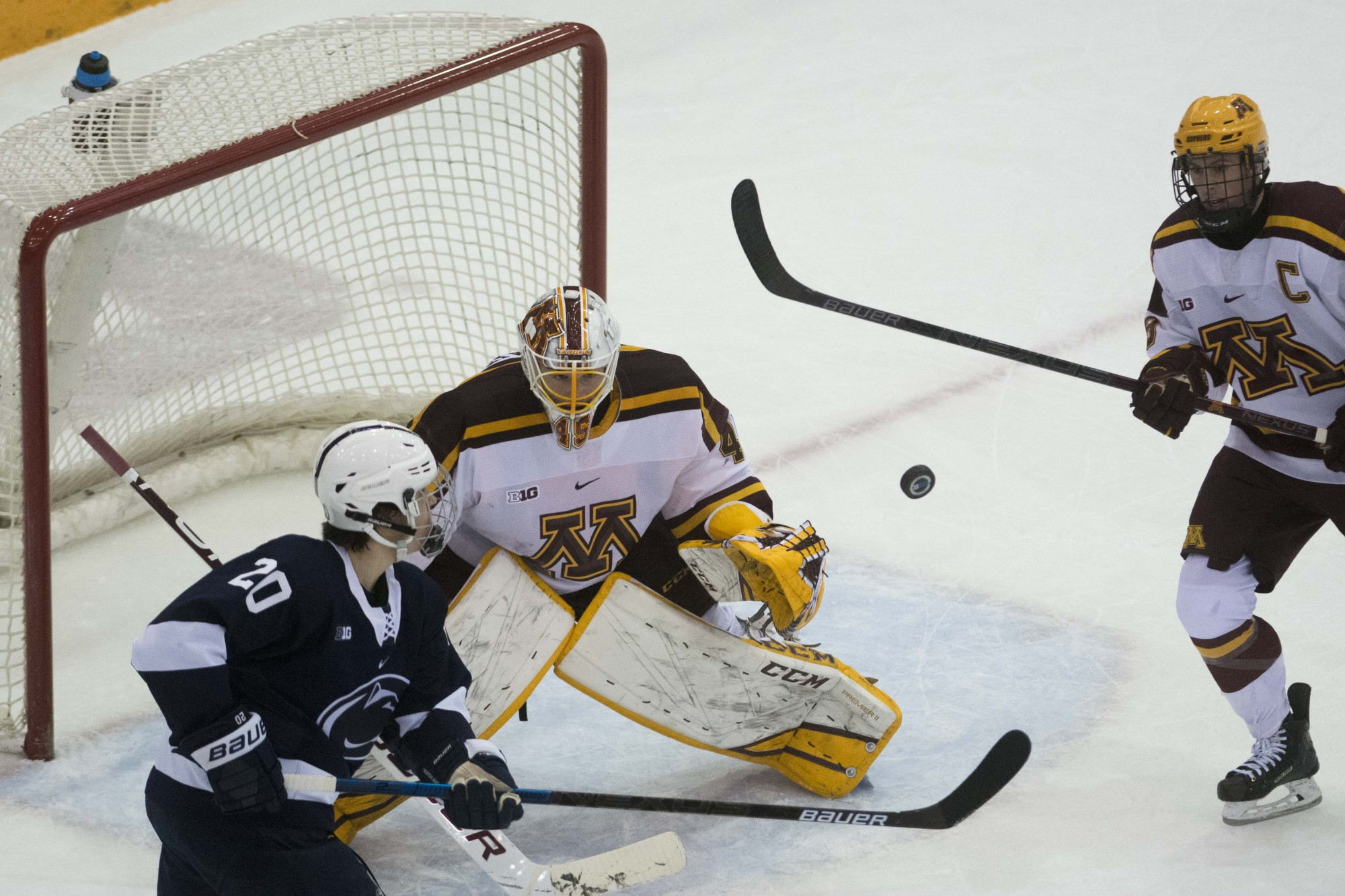 The puck flies through the air during the game against Penn State at 3M Arena at Mariucci on Friday, Nov. 15.