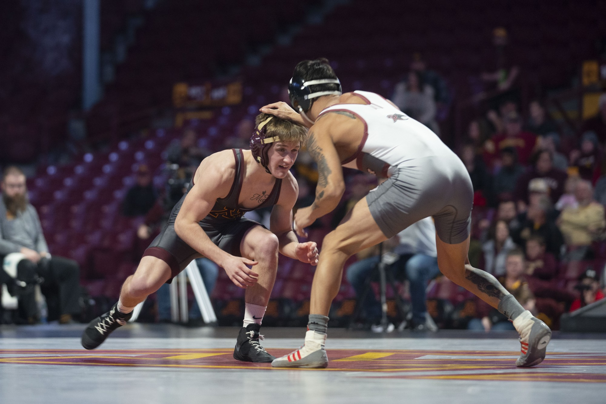 Redshirt Patrick Mckee prepares for a match with an opposing Rider wrestler at Williams Arena on Friday, Nov. 15. The Gophers went on to fall to Rider with a final score of 21-17.