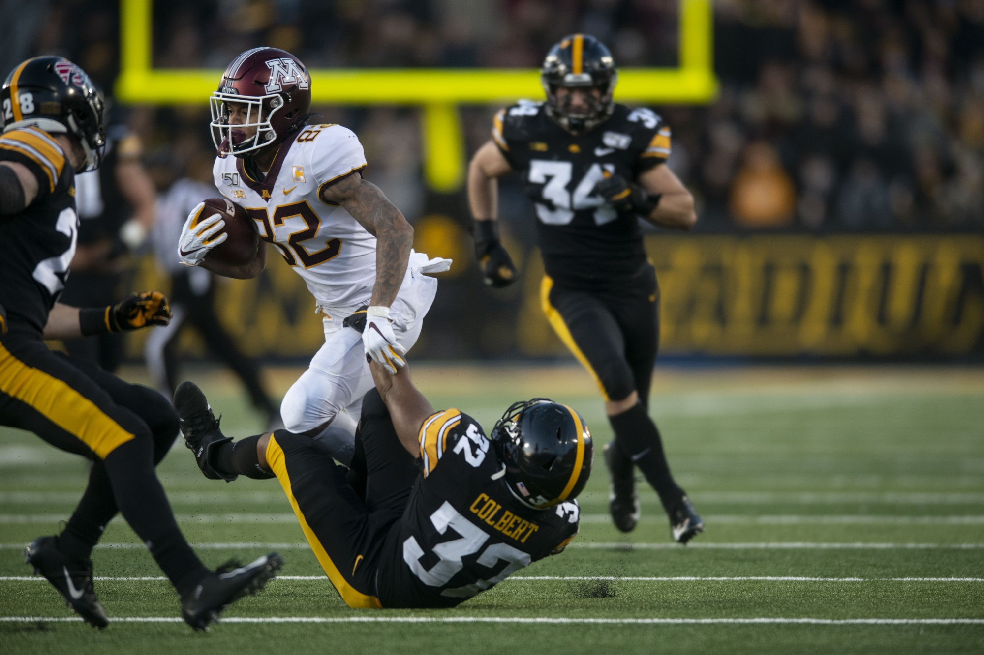 Wide receiver Demetrius Douglas carries the ball at Kinnick Stadium on Saturday, Nov. 16. Iowa defeated the Gophers 23-19 ending their winning streak and bringing their record to 9-1.