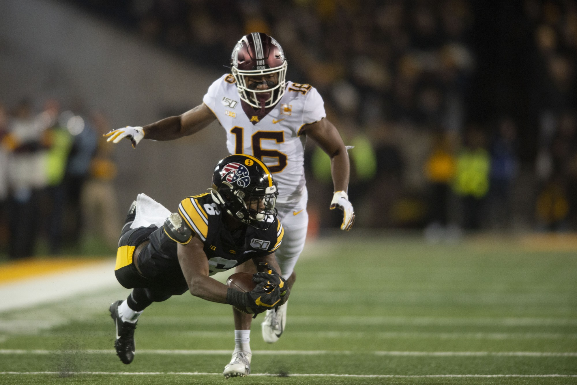 Defensive back Coney Durr chases after a receiver at Kinnick Stadium on Saturday Nov. 16. Iowa defeated the Gophers 23-19 ending their winning streak and bringing their record to 9-1.