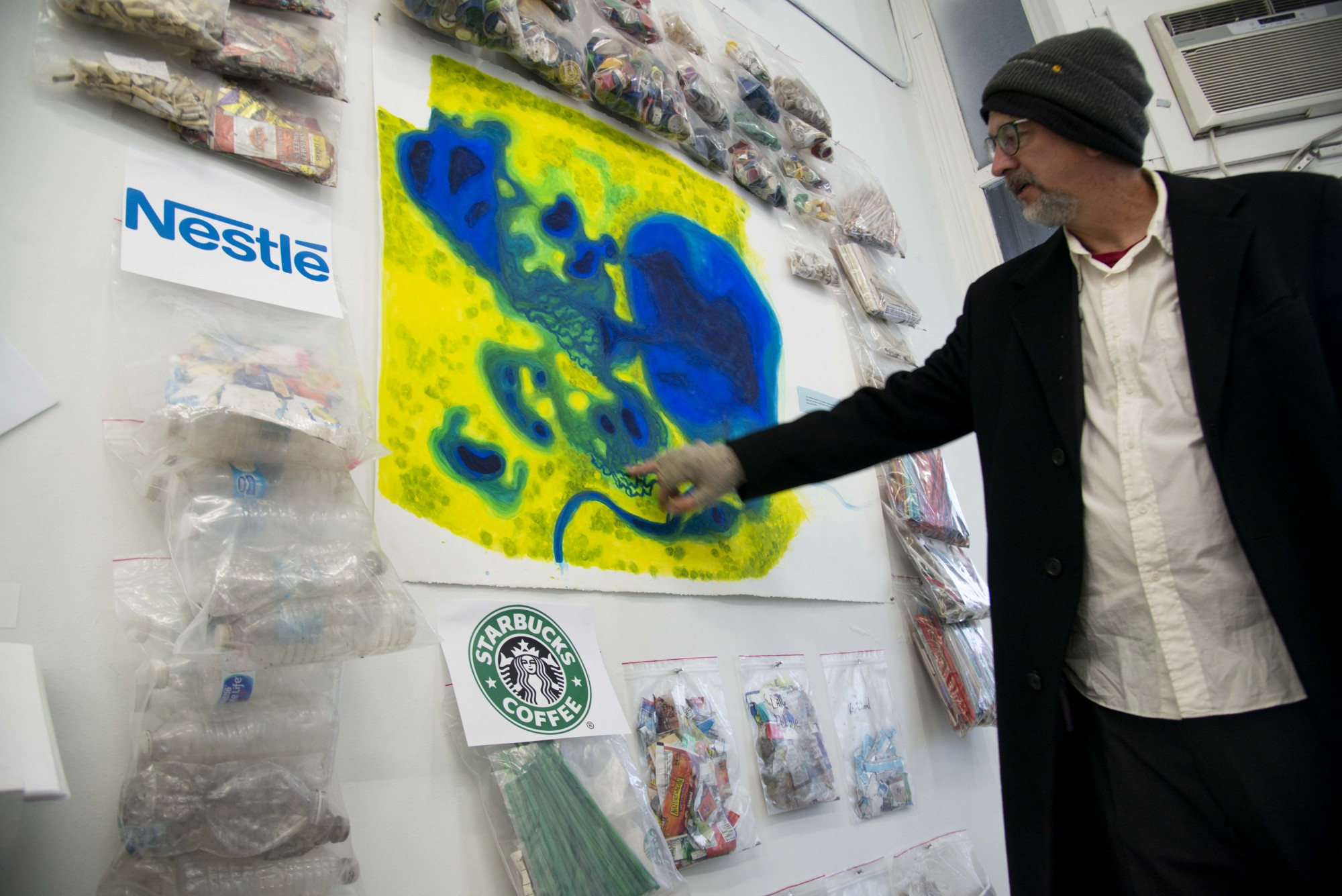 <p>Sean Connaughty, a University art professor, explains his proposal for adding new rice fields around Lake Hiawatha to improve water quality at the White Page gallery in South Minneapolis on Friday, Nov. 19. The lake, formerly called Rice Lake, is critical habitat for wildlife and has been deeply impaired by storm water pollution from South Minneapolis.</p>
