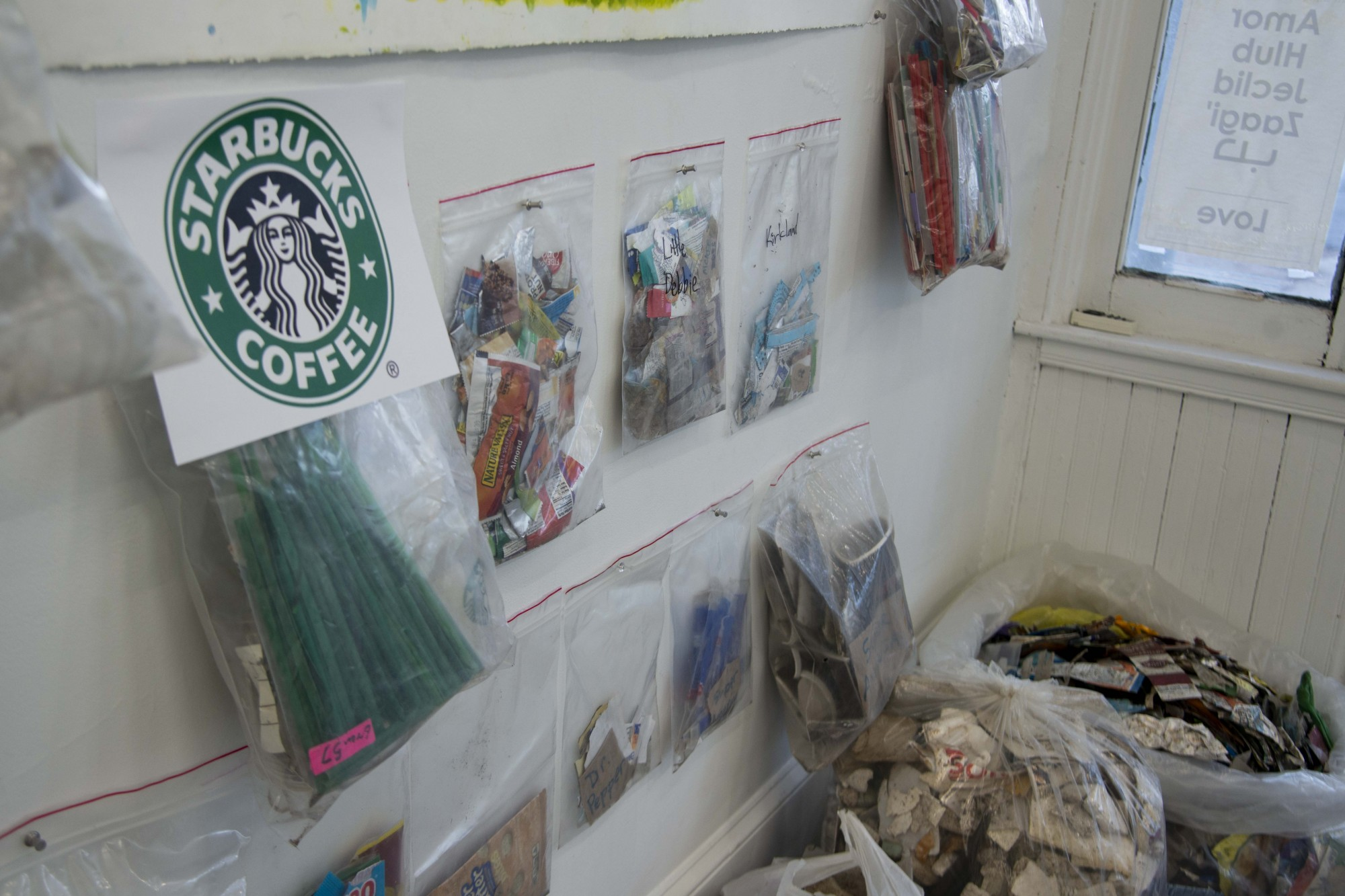Starbucks straws and other trash removed from Lake Hiawatha sit on display at The White Page gallery in South Minneapolis on Friday, Nov. 15. Since 2015, 6,800 pounds of trash have been removed under Sean Connaughty's stewardship.