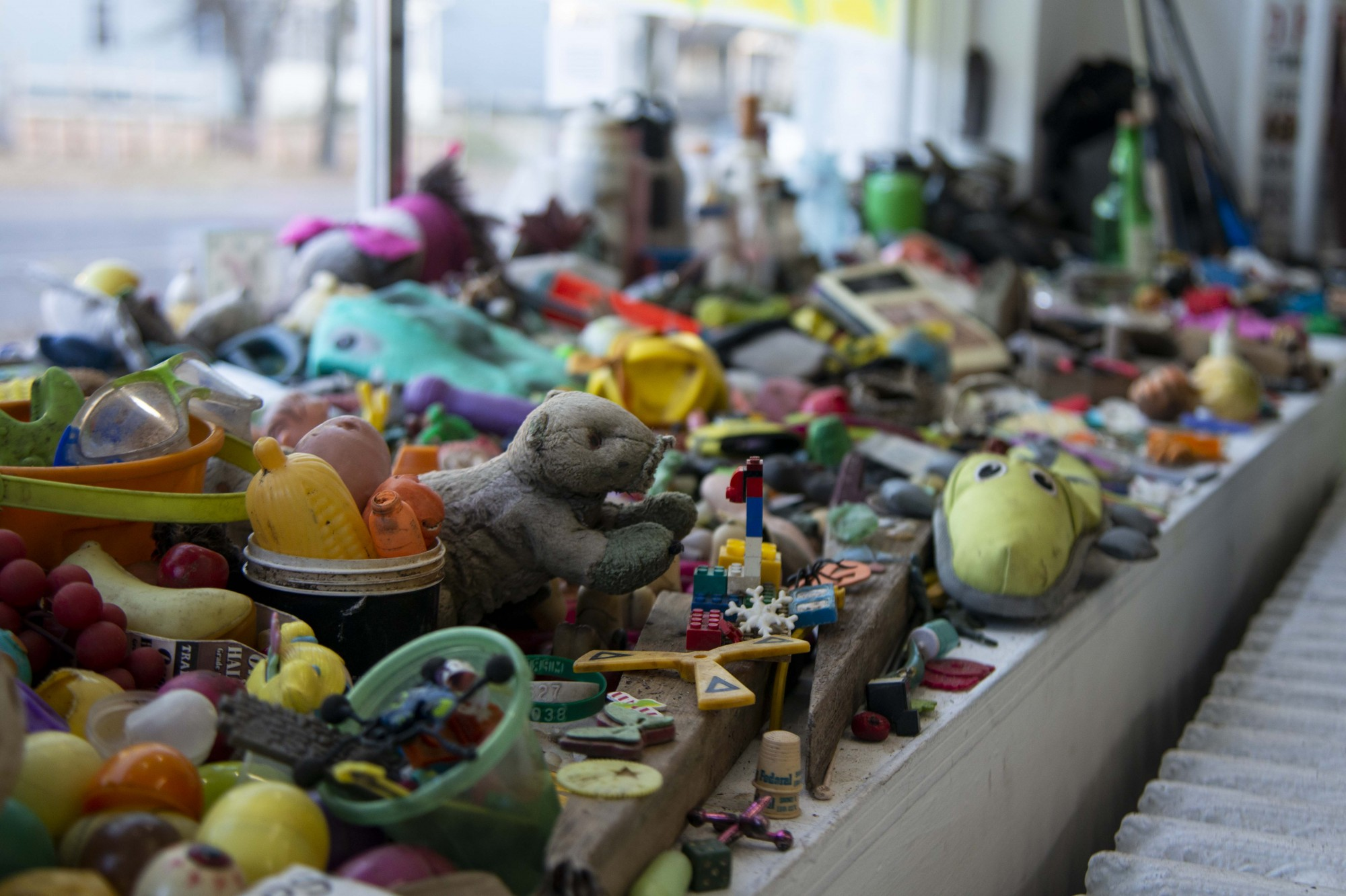Toys that have been collected from Lake Hiawatha sit on display at The White Page gallery on Friday, Nov. 15. Since 2015, 6,800 pounds of trash have been removed under Sean Connaughty's stewardship.