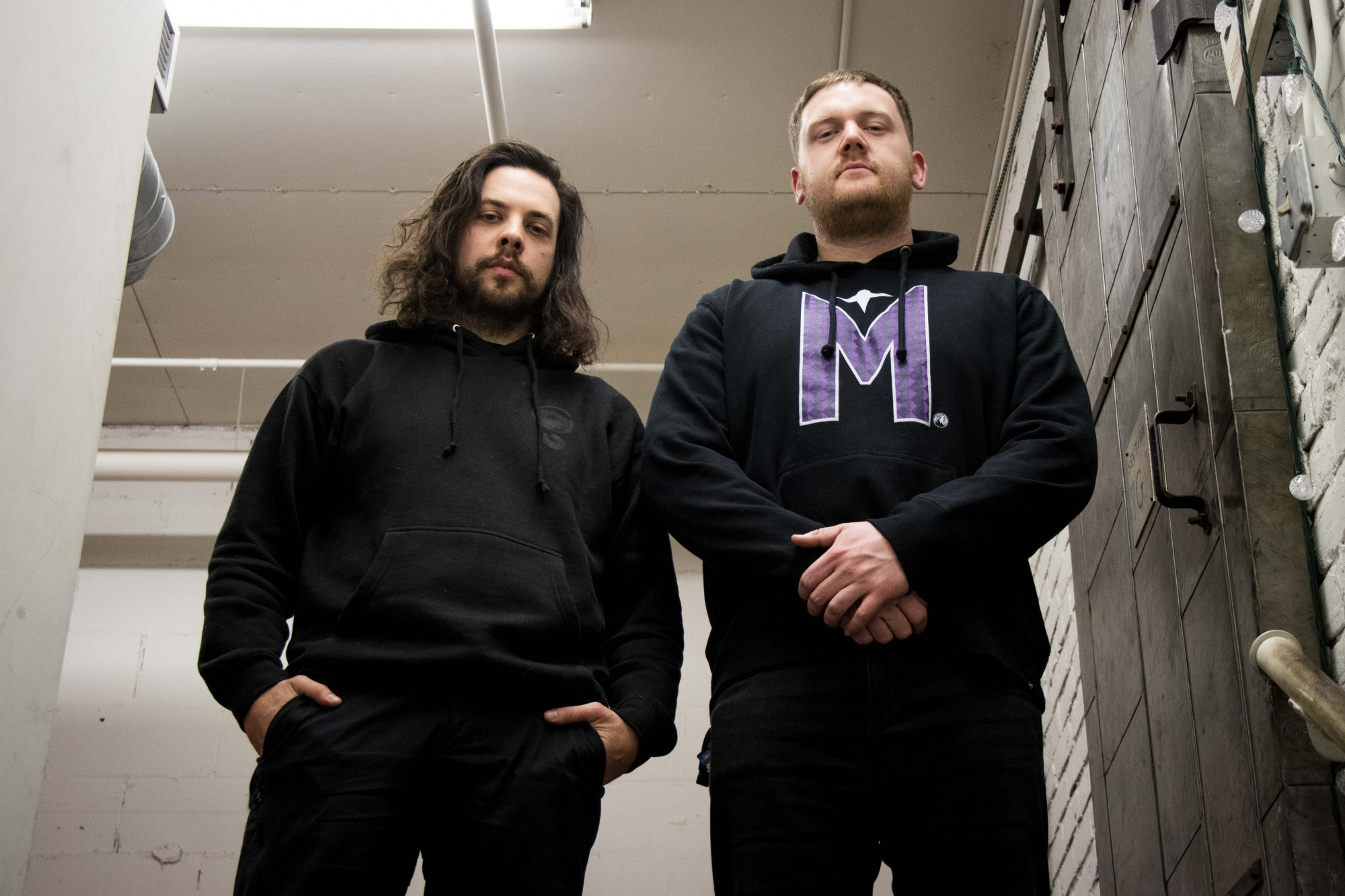 Jim Brenk, left, and Cameron Dickison, right, who make up the electronic music duo Niles Shepard, pose for a portrait in their studio space next to Bauhaus Brew Labs on Thursday, Nov. 14.