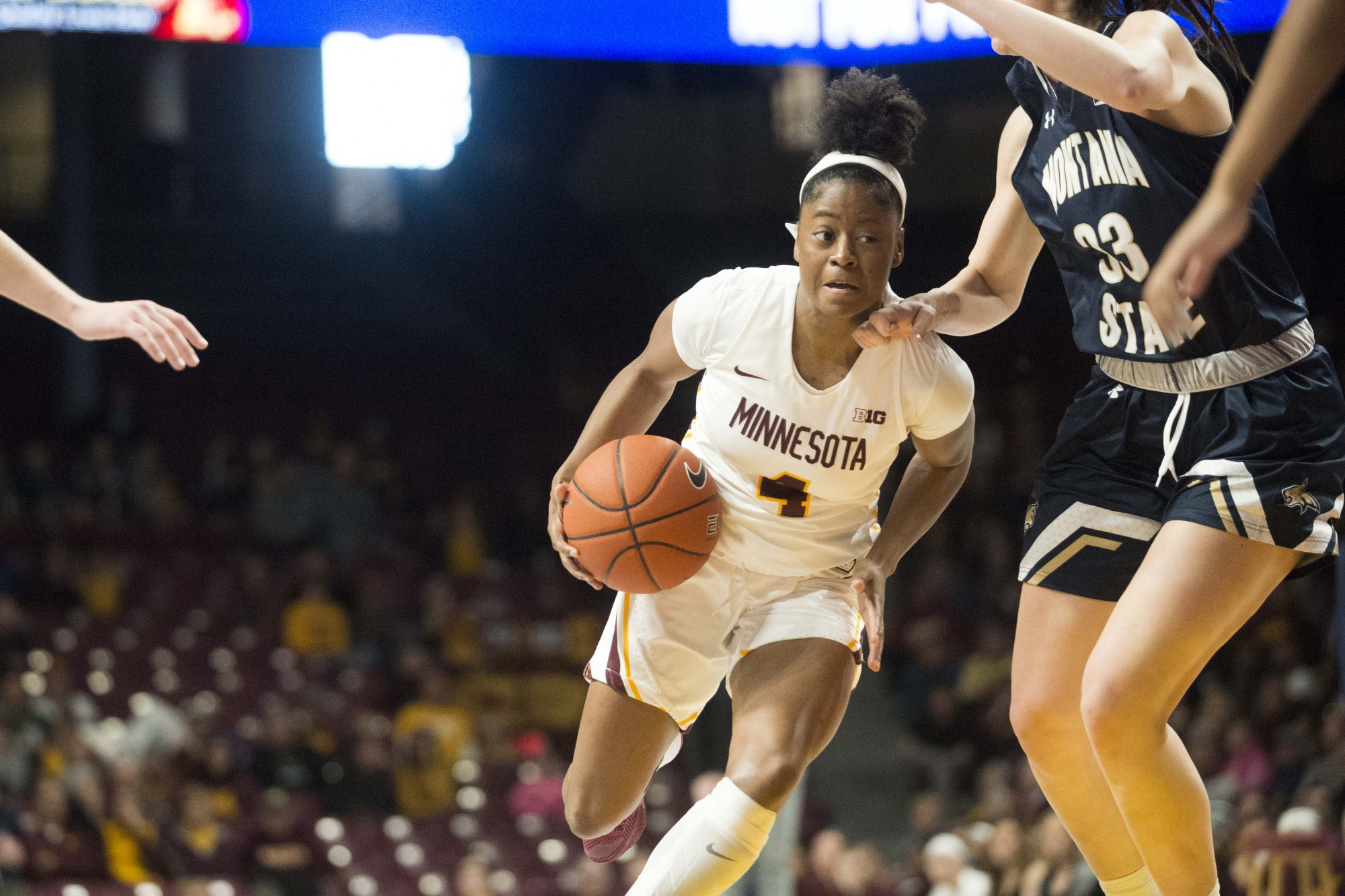 Guard Jasmine Powell dribbles the ball through defenders at Williams Arena on Saturday, Nov. 23. The Gophers went on to defeat Montana State 71-60.