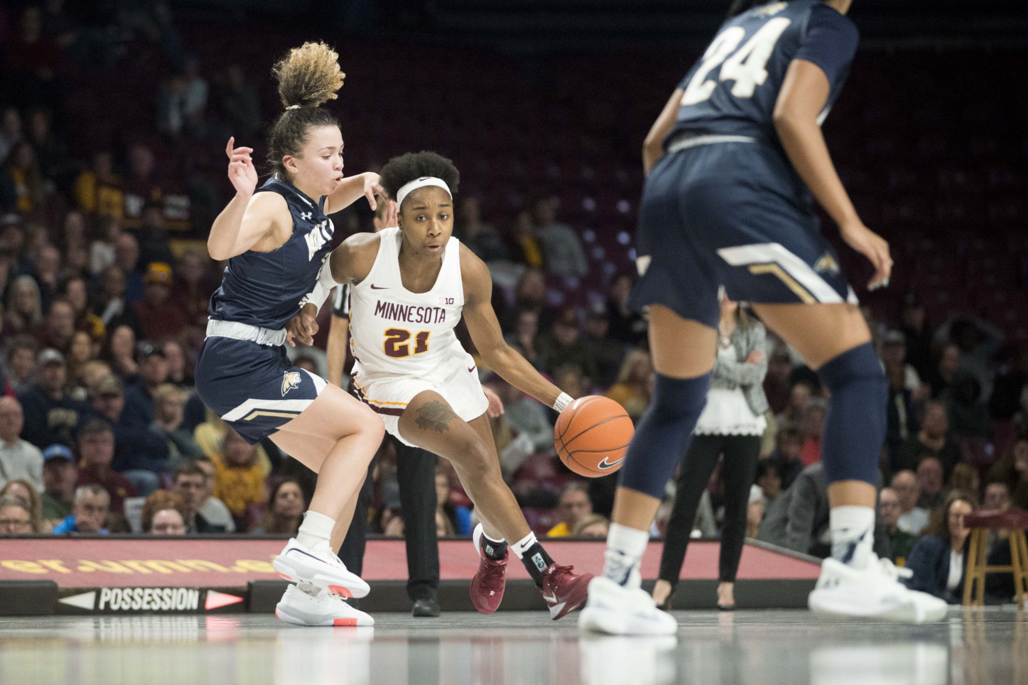 Guard Jasmine Brunson dribbles the ball through defenders in Williams Arena on Saturday, Nov. 23. The Gophers went on to defeat Montana State 71-60.