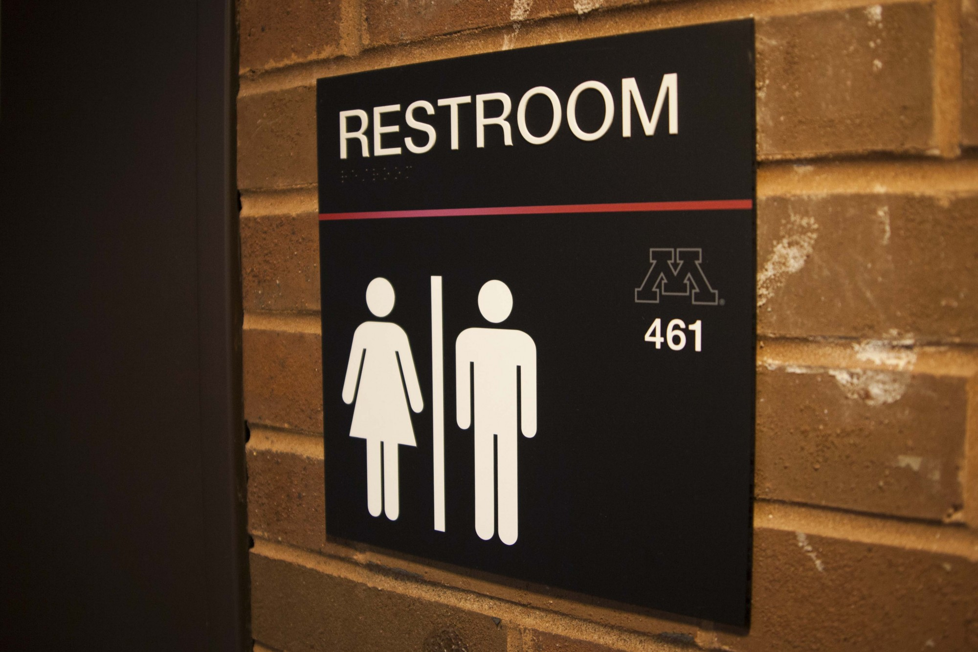 One of two existing gender-neutral restrooms in Walter F. Mondale Hall is seen in the Law Library on Wednesday, Nov. 20. The Law Council recently expressed their support for implementing additional gender-neutral restrooms in the building despite some student opposition.