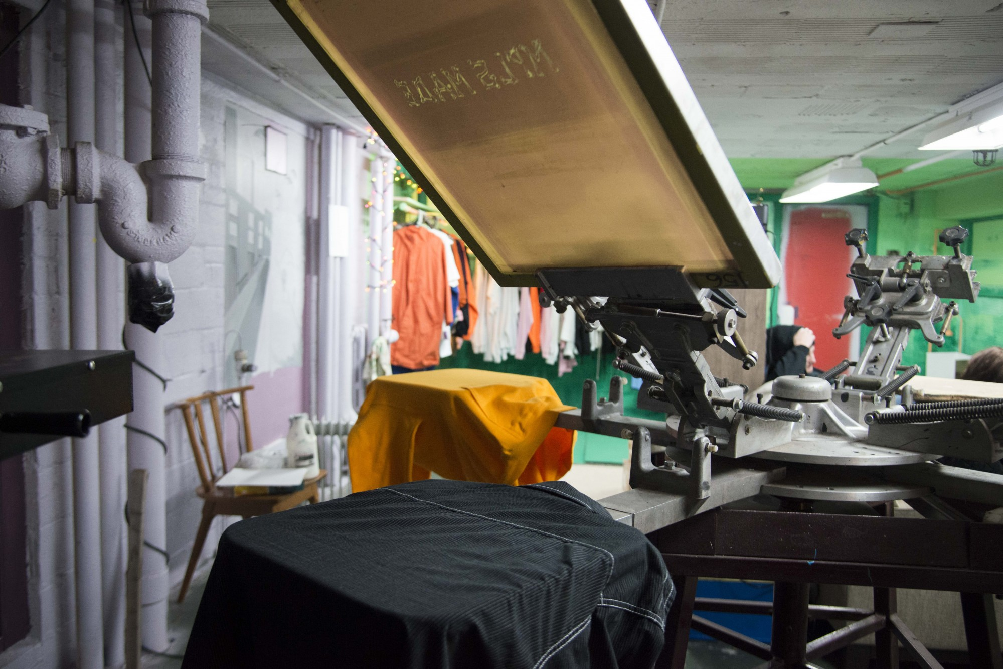 A screen printing press as seen in Elena Bagne's new studio space in Northeast Minneapolis on Wednesday, Nov. 20. Bagne started MPLS MADE over two years ago as a custom hand-drawn and printed streetwear brand that uses thrifted clothing in an effort to be a sustainable.