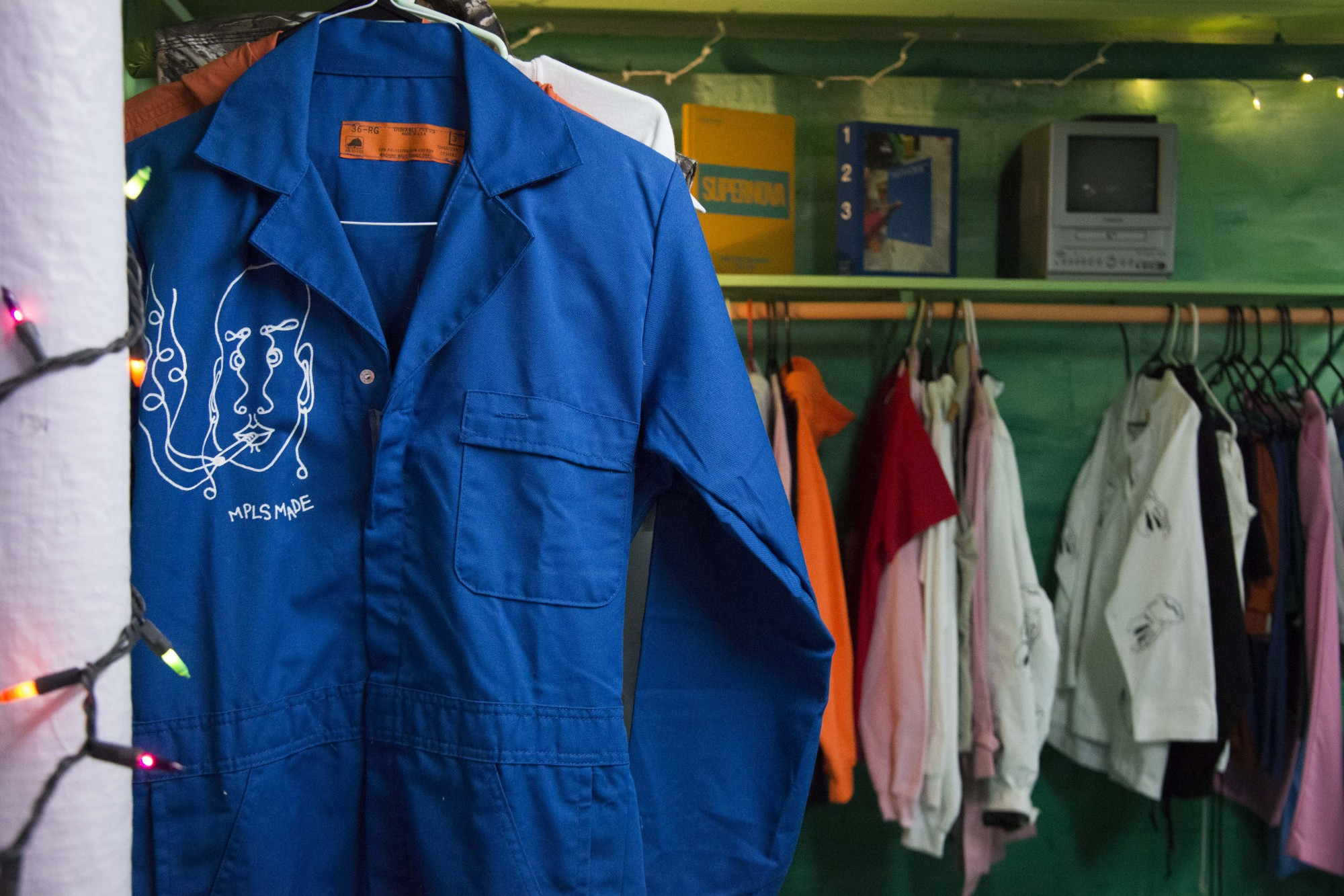 <p>A MPLS MADE jumpsuit hangs on display in Elena Bagne's studio space in Northeast Minneapolis on Wednesday, Nov. 20. MPLS MADE is a custom hand-drawn and printed streetwear brand that uses thrifted clothing in an effort to be a sustainable. </p>