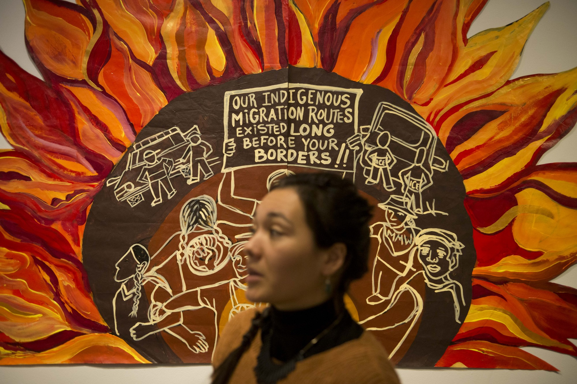 Magdalena Kaluza, one of the contributing artists at the Power of Vision Gallery Exhibit discusses a mural that was was worked on from April to September on Thursday, Nov.21. (Parker Johnson / Minnesota Daily)