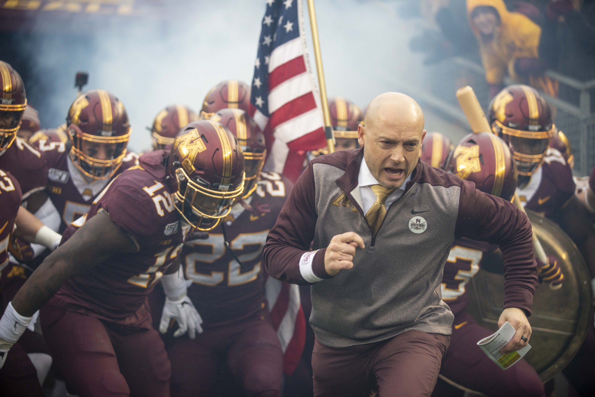 The Gophers make their entrance onto the field at TCF Bank Stadium on Saturday, Nov. 30.