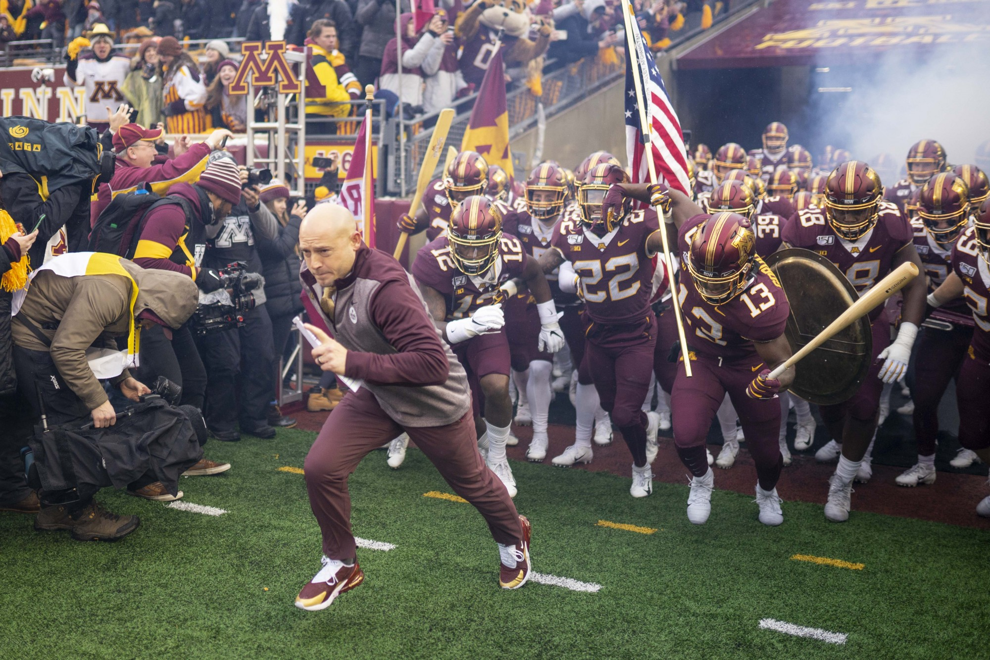 Head Coach P.J. Fleck runs onto the field before the start of the game at TCF Bank Stadium on Saturday, Nov. 30.