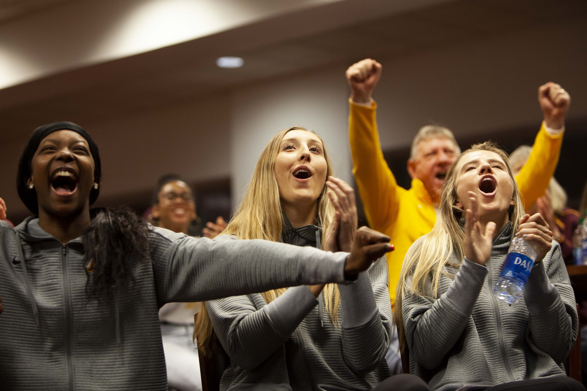 From left, Gophers Adanna Rollins, Shea Rubright and CC McGraw cheer upon hearing their ranking at the NCAA Championship seed announcements at Williams Arena on Sunday, Dec. 1.  Minnesota, ranked seventh, is slated to play Fairfield University in the first round.
