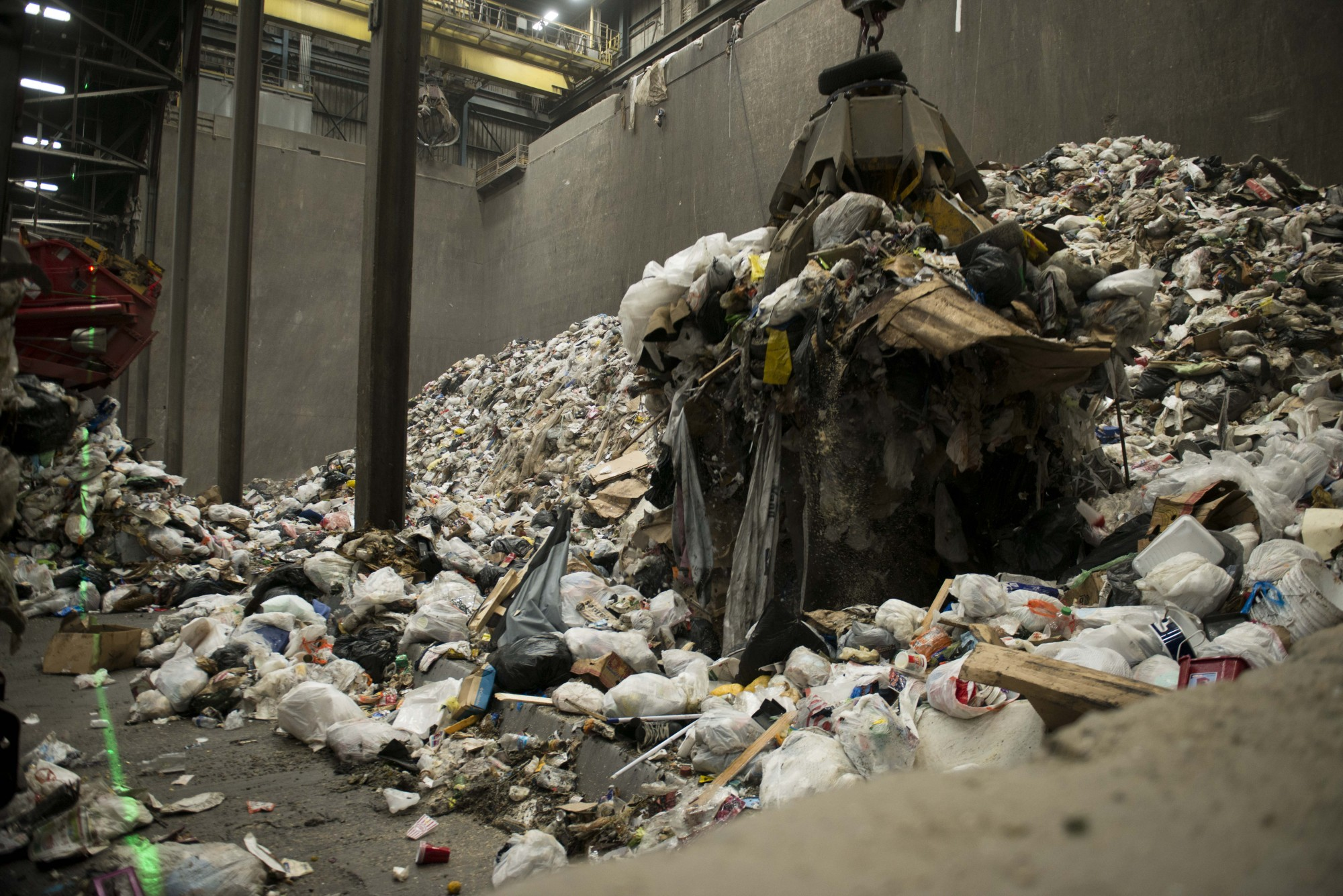 A crane picks up trash to be distributed in bins and transported to the incinerator at the Hennepin Energy Recovery Center in Minneapolis on Wednesday, Dec. 4.