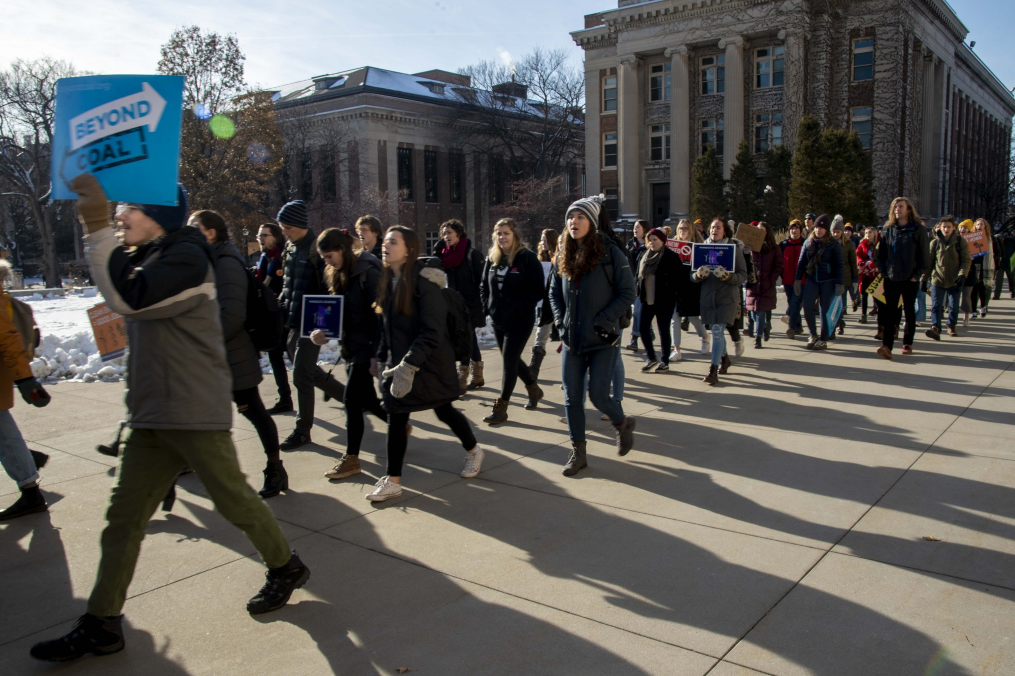 <p>Students and faculty march towards Morrill Hall as part of the UMN Climate Strike on Friday, Dec. 6. Those in attendance criticized the University's policies on fossil fuel usage.</p>