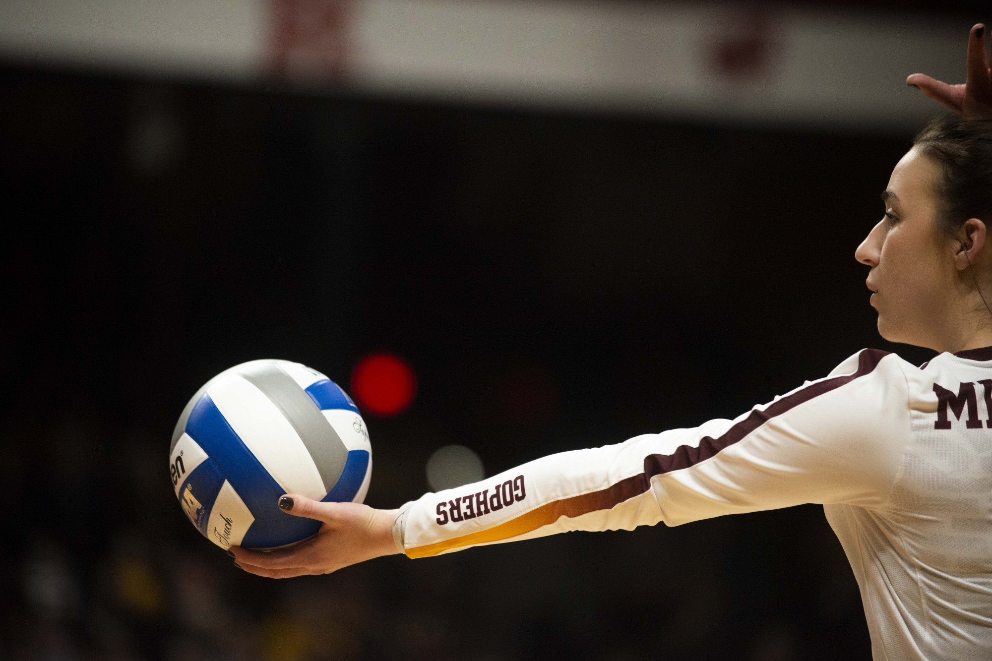 Libero Rachel Kilkelly prepares to serve the ball during the game against the Fairfield Stags in the first round of the NCAA tournament at the Maturi Pavilion on Friday, Dec. 6.