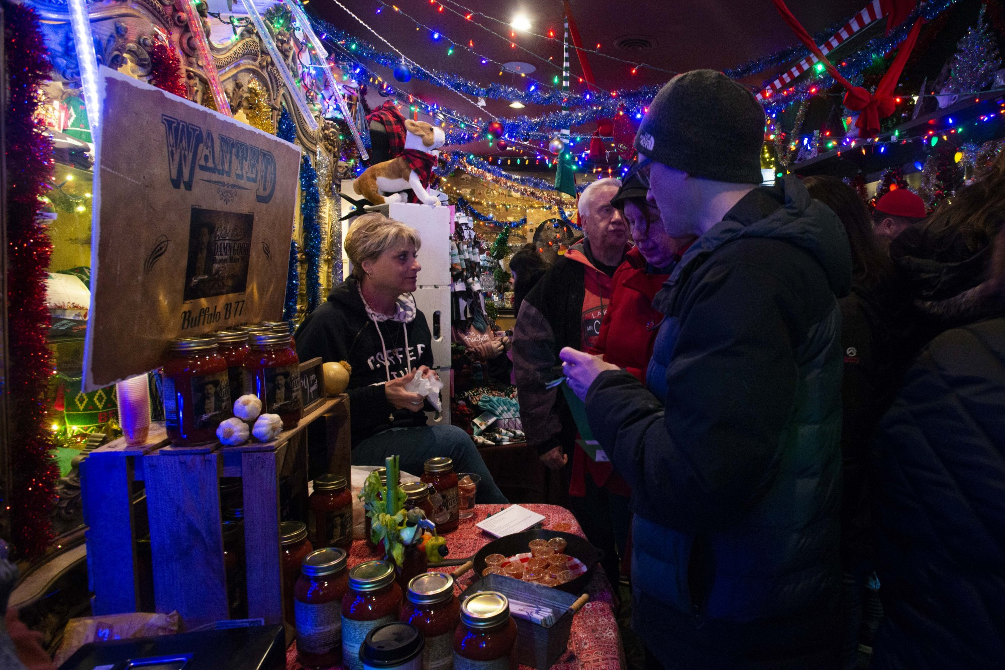 A visitor tastes a sample of the Bloody Mary mix being sold by Mary Johnson (left) at Betty Danger's Country Club in North-east Minneapolis on Saturday, Dec. 7. The club held its 4th Annual Betty's Bizarre Bazaar which is an event for local artists to sell their art and homemade food supplies.
