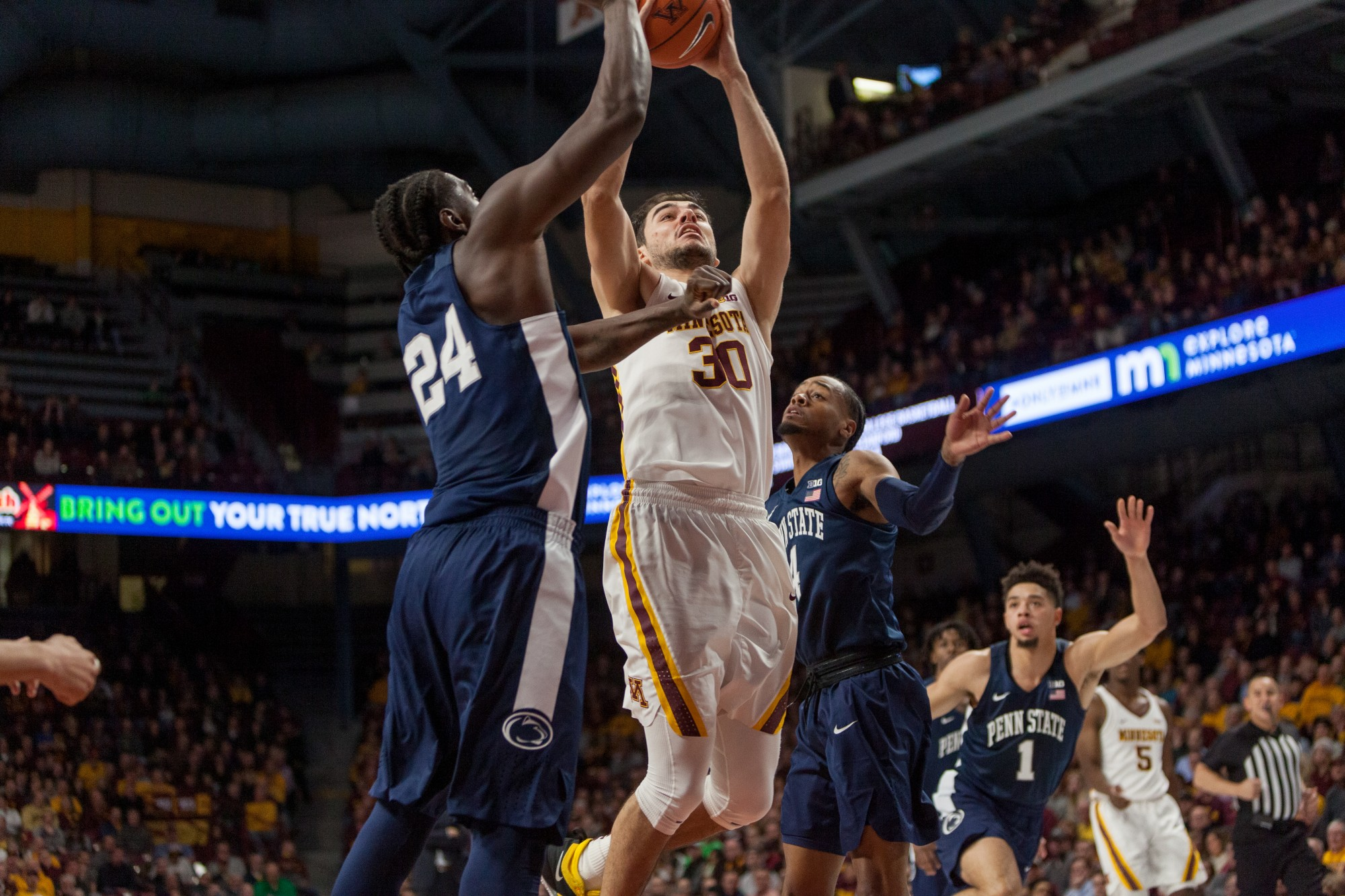 Gophers Forward Alihan Demir attempts a dunk at Williams Arena on Wednesday, Jan. 15.  Minnesota defeated the Penn State Nittany Lions 75-69. (Kamaan Richards / Minnesota Daily)