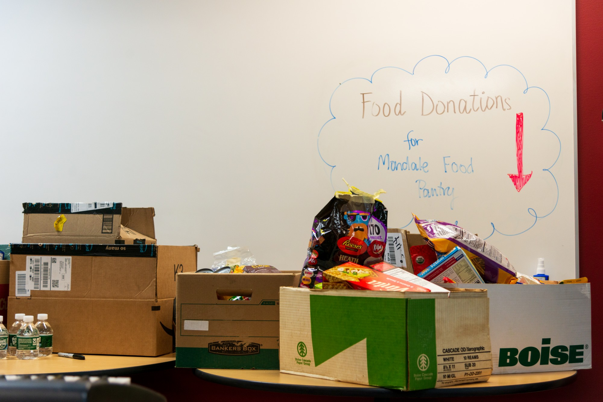 A row of tables stacked with non-perishable food items stands ready to be served in Mondale Hall on Monday, Jan. 20. Known as