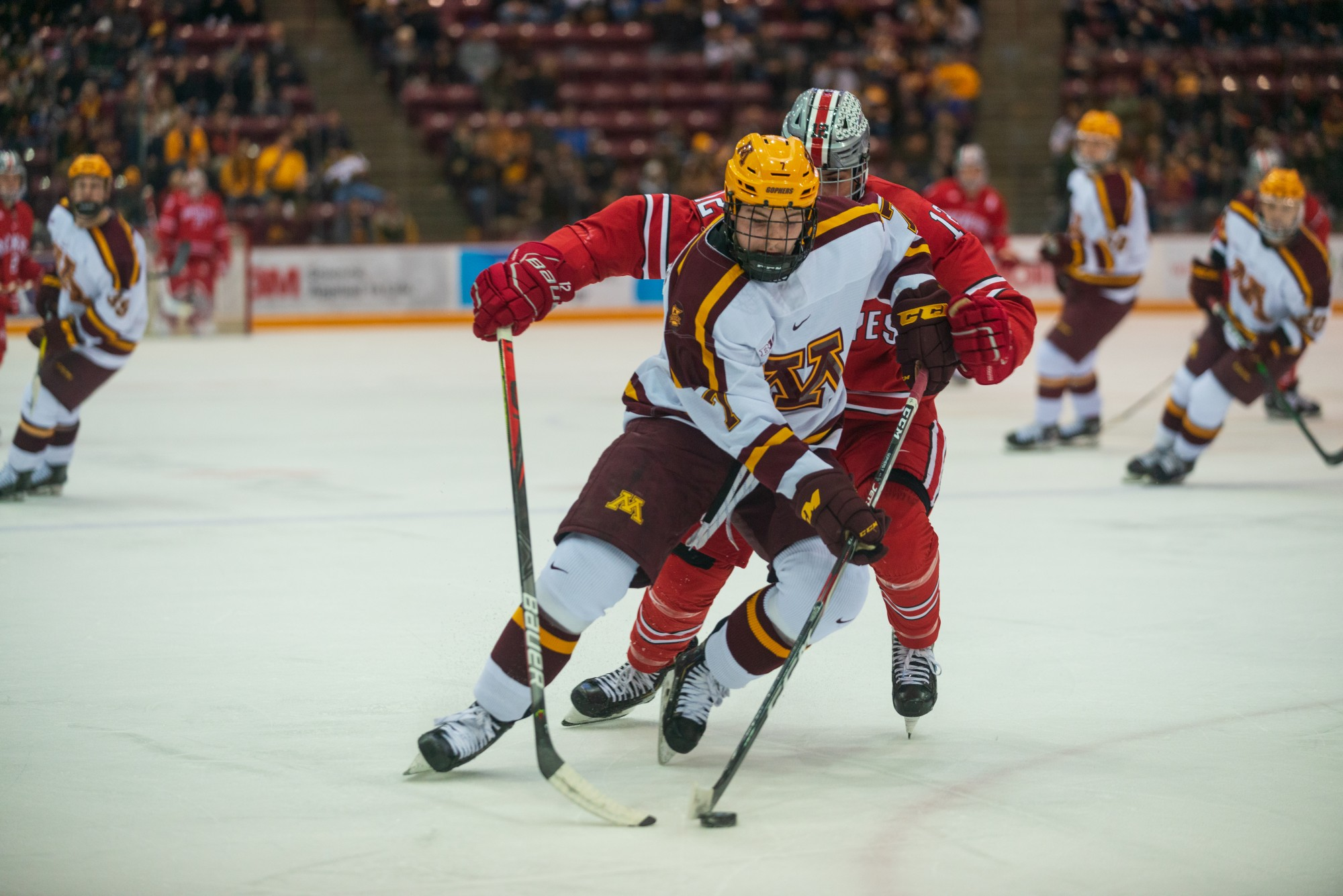 Gophers Forward Brannon McManus protects the puck from a defender at 3M Arena at Mariucci on Friday, Jan. 24, 2020. The Gophers ended the night with a 6-3 victory over Ohio State.