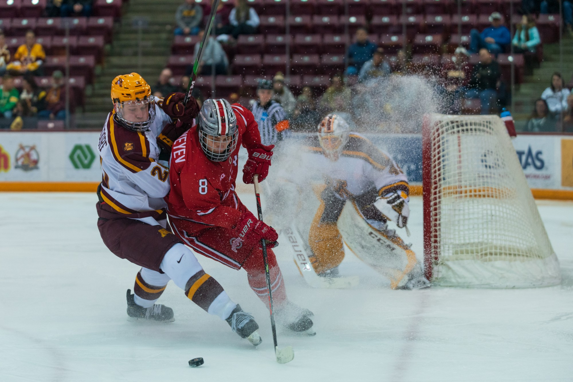 Gophers Defenseman Ryan Zuhlsdorf collides with an Ohio State player at 3M Arena at Mariucci on Friday, Jan. 24, 2020. The Gophers ended the night with a 6-3 victory over Ohio State.