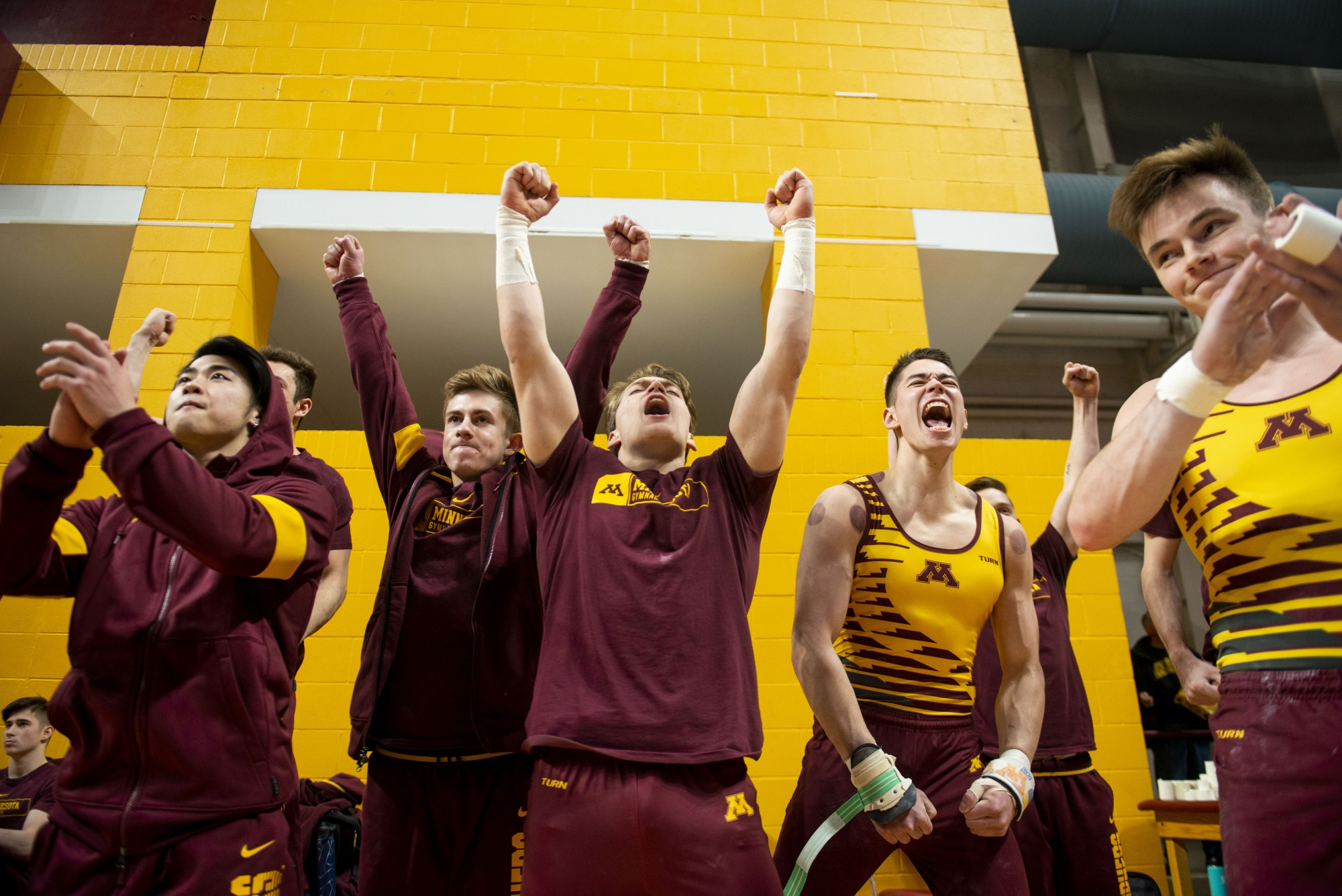 The Gophers cheer for a teammate during their meet against the Fighting Illini at the Maturi Pavilion on Friday, Jan. 24.