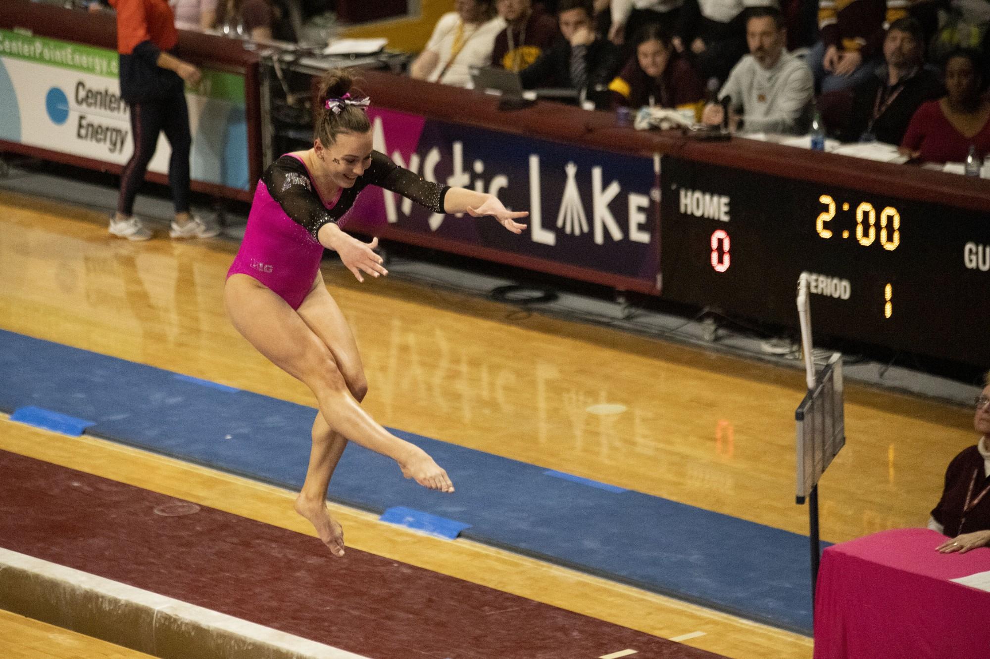 Lexy Ramler competes on the beam at the Maturi Pavillion on Saturday, Jan. 25, 2020.