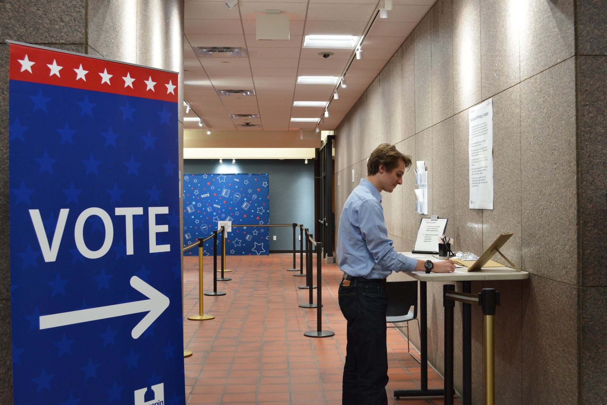Senior Sammy Lett reviews an early voting ballot at the Hennepin County Government Center on Wednesday, Jan. 22.