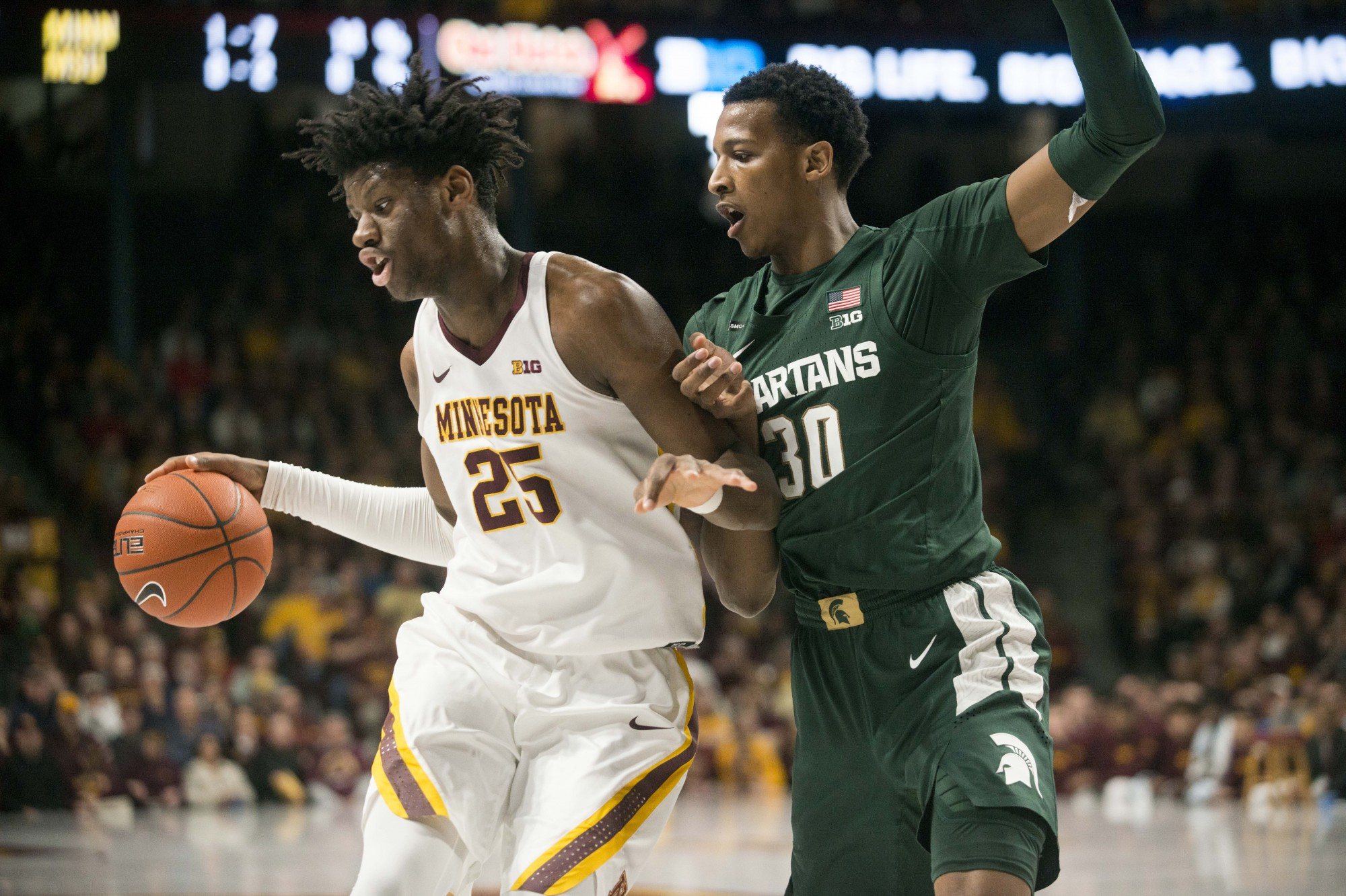 Center Daniel Oturu drives the ball through a defender at Williams Arena on Sunday, Jan. 26. The Gophers lost to the Michigan State Spartans 70-52.