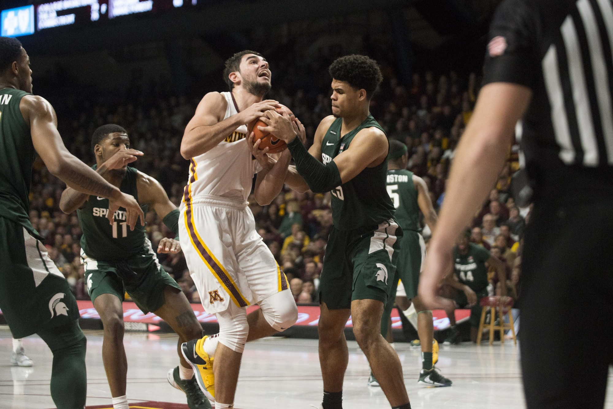 Forward Alihan Demir fights for the ball at Williams Arena on Sunday, Jan. 26. The Gophers lost to the Michigan State Spartans 70-52.