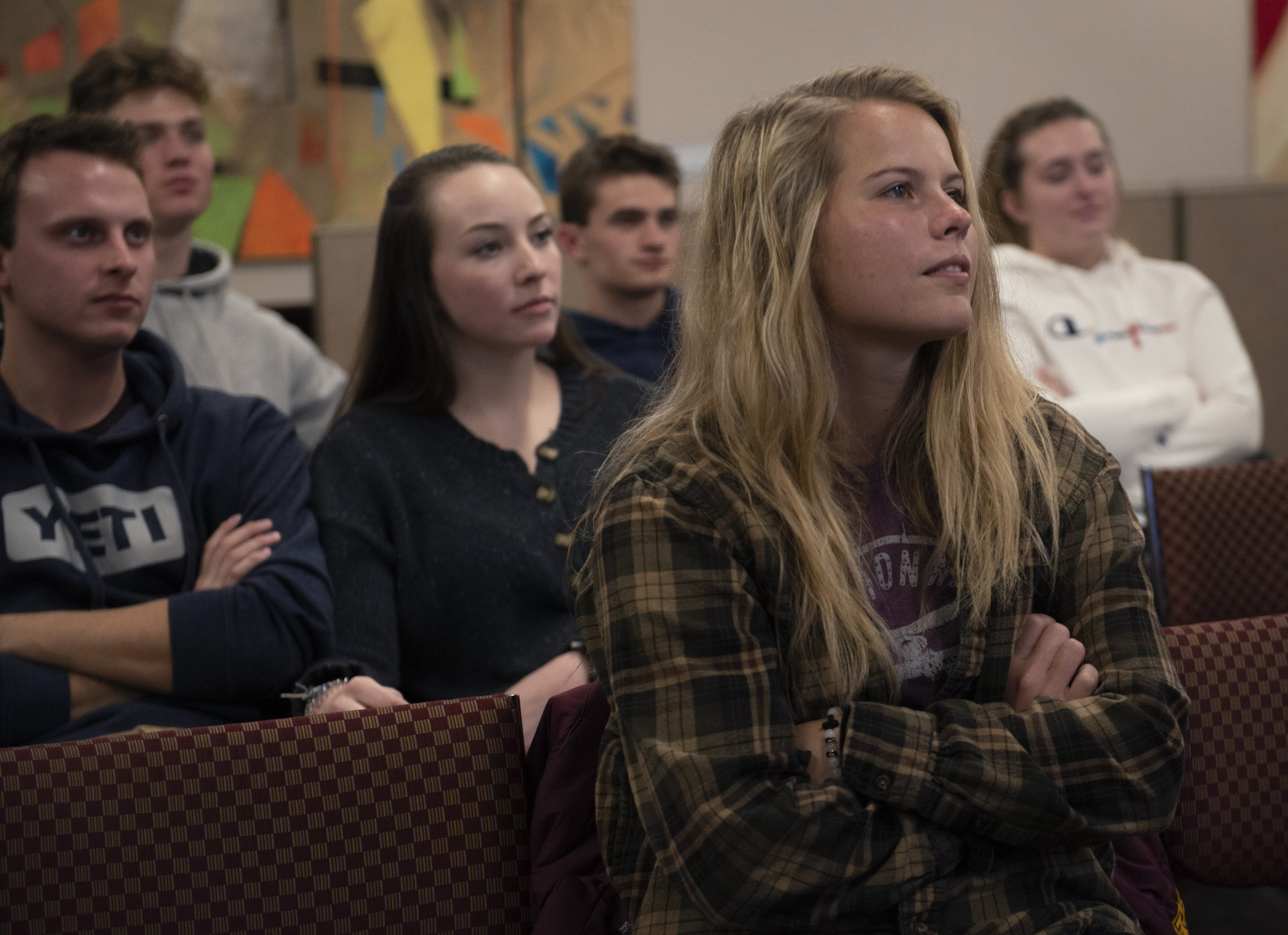 Emily Hansen watches a re-election campaign video for President Trump with other students at the end of a meeting put on by The Collegiate Group for Trump in Coffman Union on Tuesday, Jan. 21.