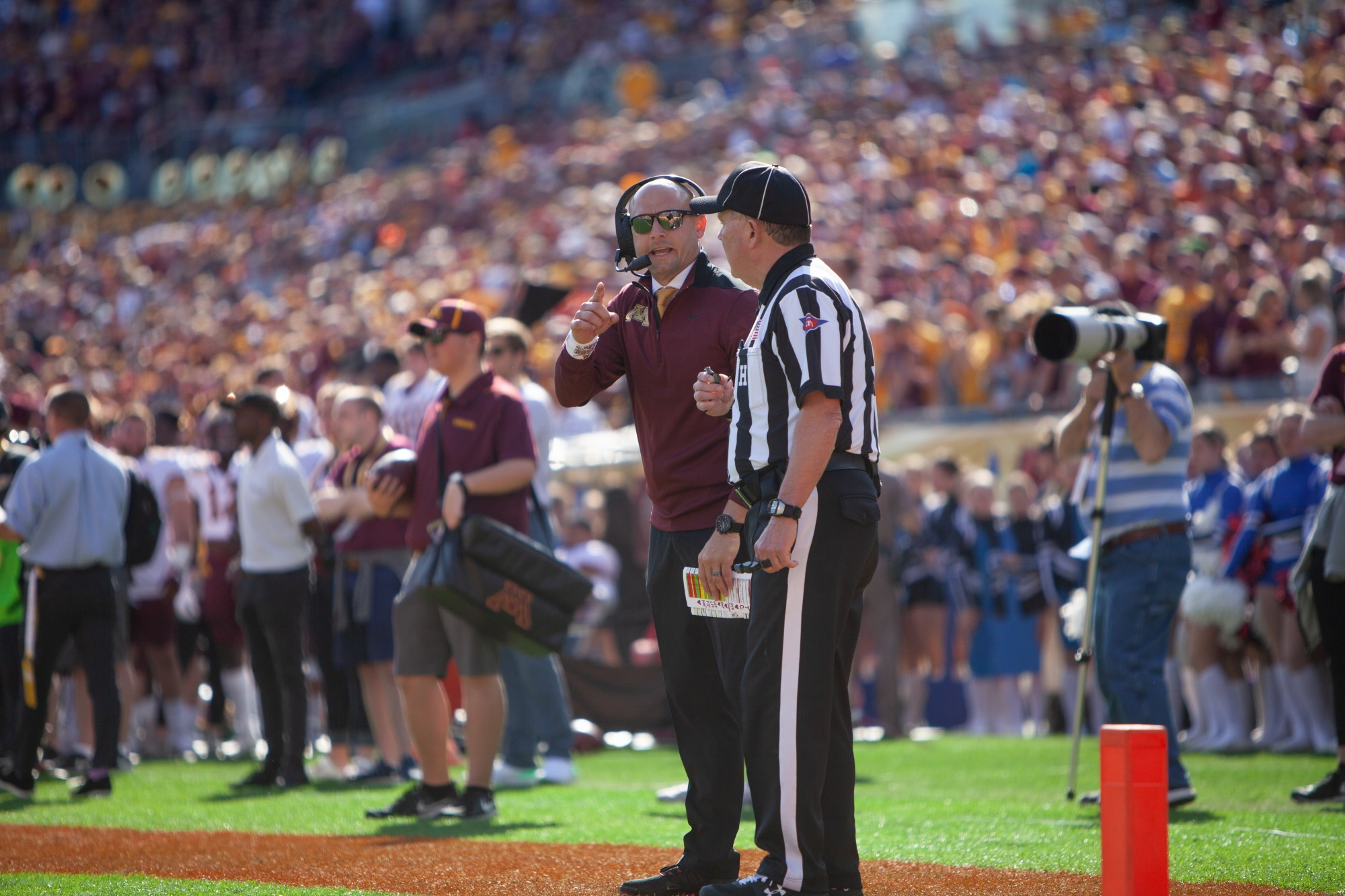 Gophers Head Coach P.J. Fleck converses with a referee at Raymond James Stadium in Tampa, Florida on Wednesday, Jan. 1. Minnesota holds a 24-17 lead over Auburn heading into the third quarter of the Outback Bowl. (Kamaan Richards / Minnesota Daily)