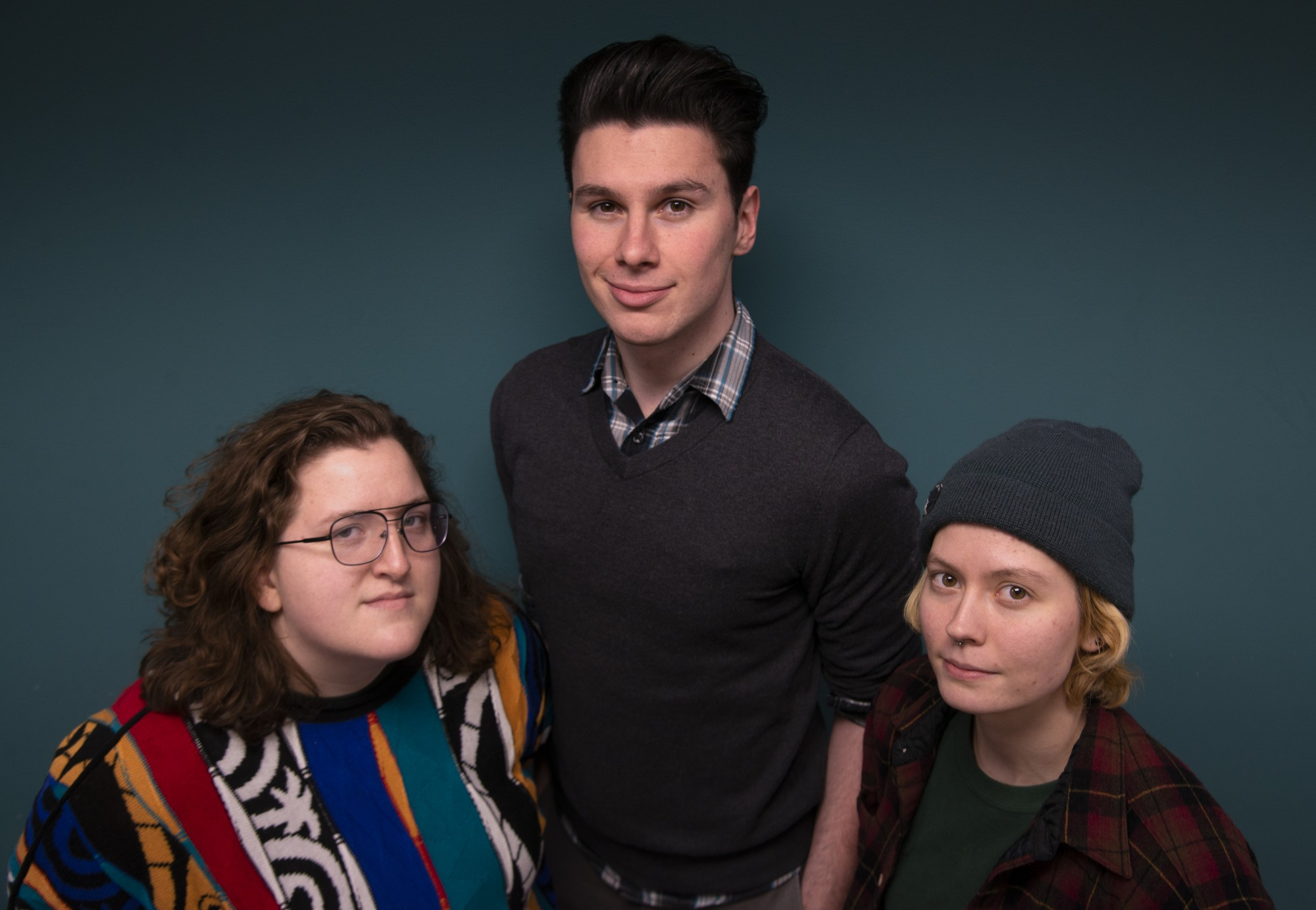 From left, Loring Collective board members Melissa Riper, Tony Burton and Izzy Voigt pose for a portrait on Friday, Feb. 7. The group aims to empower queer creatives in the Twin Cities by creating platforms for authentic expression and facilitating collaboration.