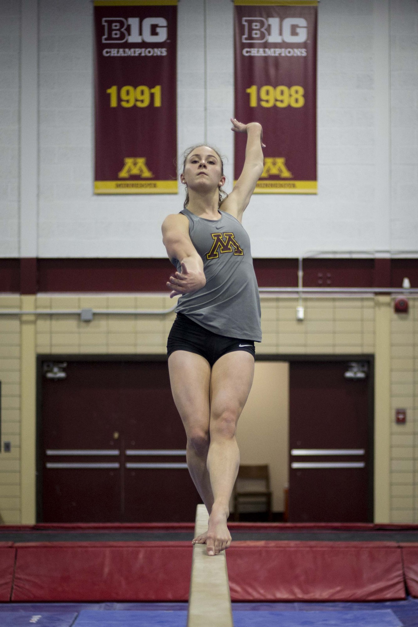 Gymnast Lexi Ramler poses on the beam in the Peik Gym on Thursday, Jan. 30. Ramler scored a perfect 10 in two consecutive weeks during meets against Rutgers and Illinois.