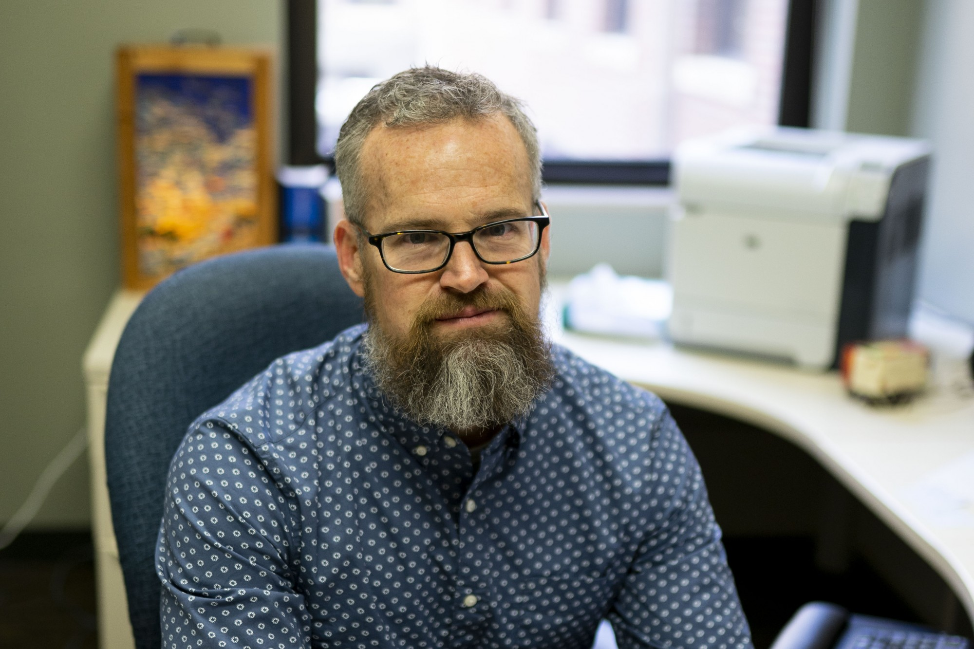 Jude Mikal, whose research is examining the relationship between quantitative and qualitative data, poses for a portrait in his office on Tuesday, Feb. 4. (Parker Johnson / Minnesota Daily)