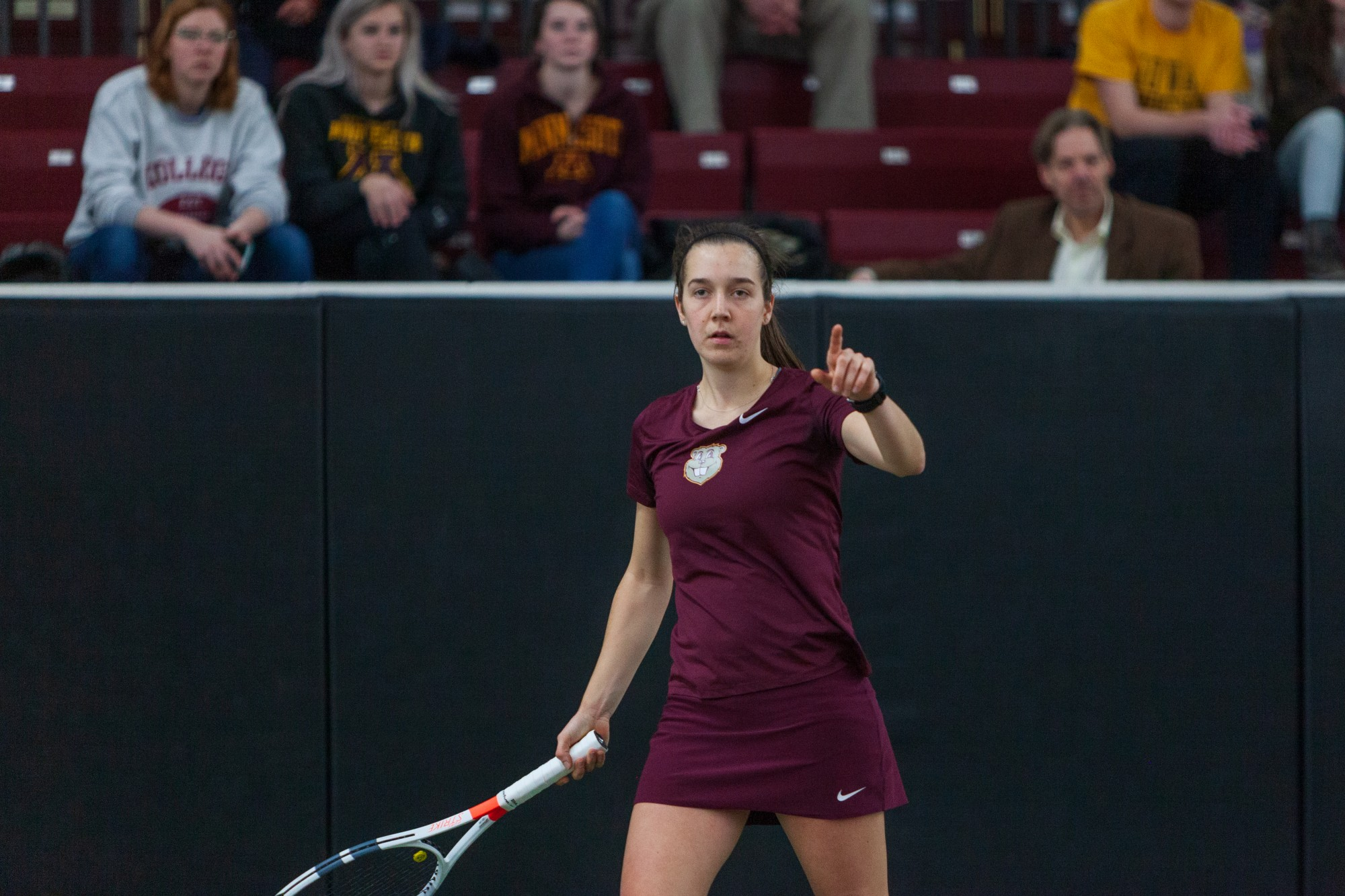 Gophers Senior Cammy Frei signals to her teammate at the Baseline Tennis Center on Friday, Feb. 7.
