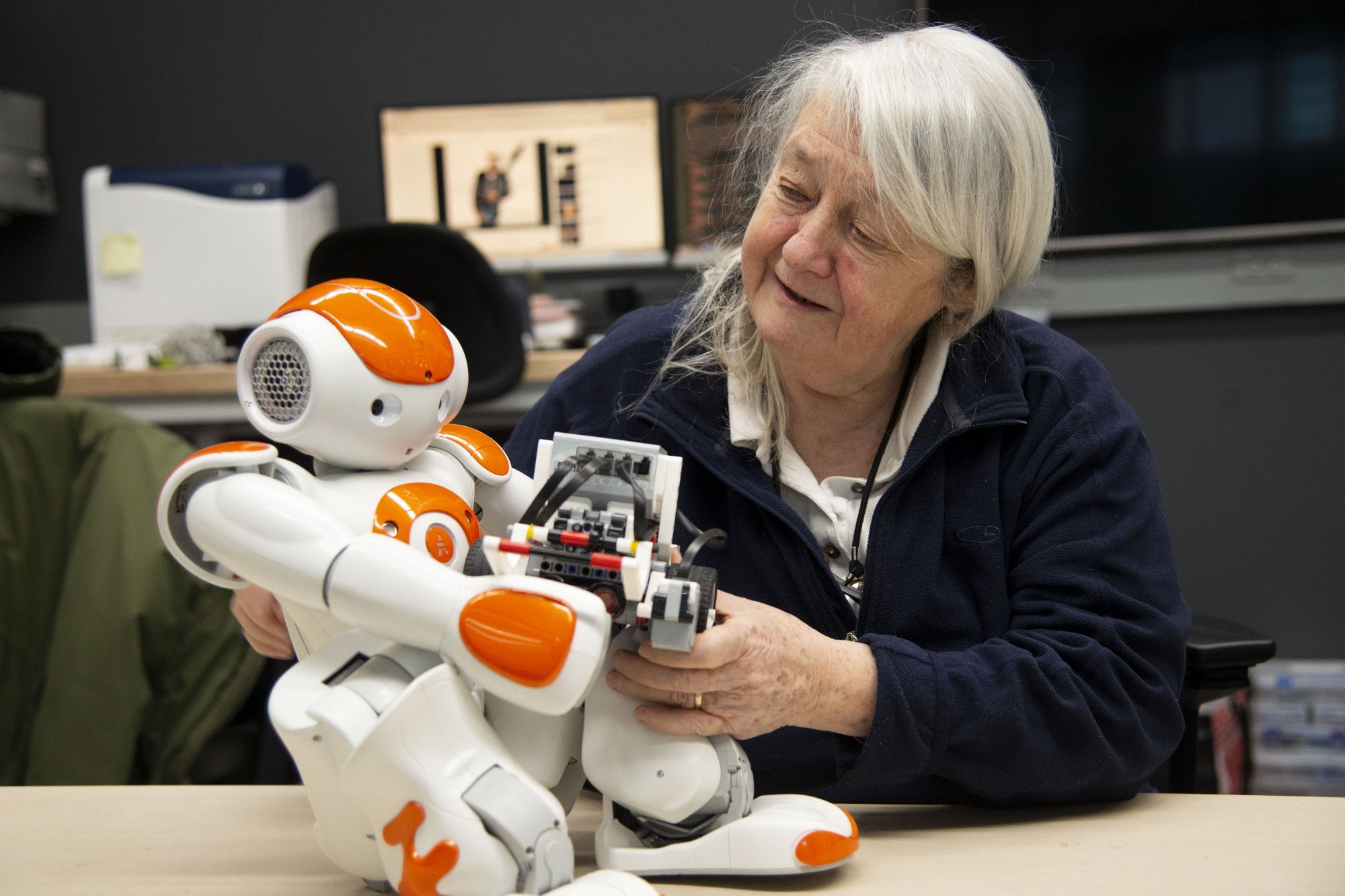 Dr. Maria Gini, a professor of robotics, observes a robot in Shepherd Labs on Thursday, Feb. 6. Starting this fall, the University will be offering a Master's program for robotics.