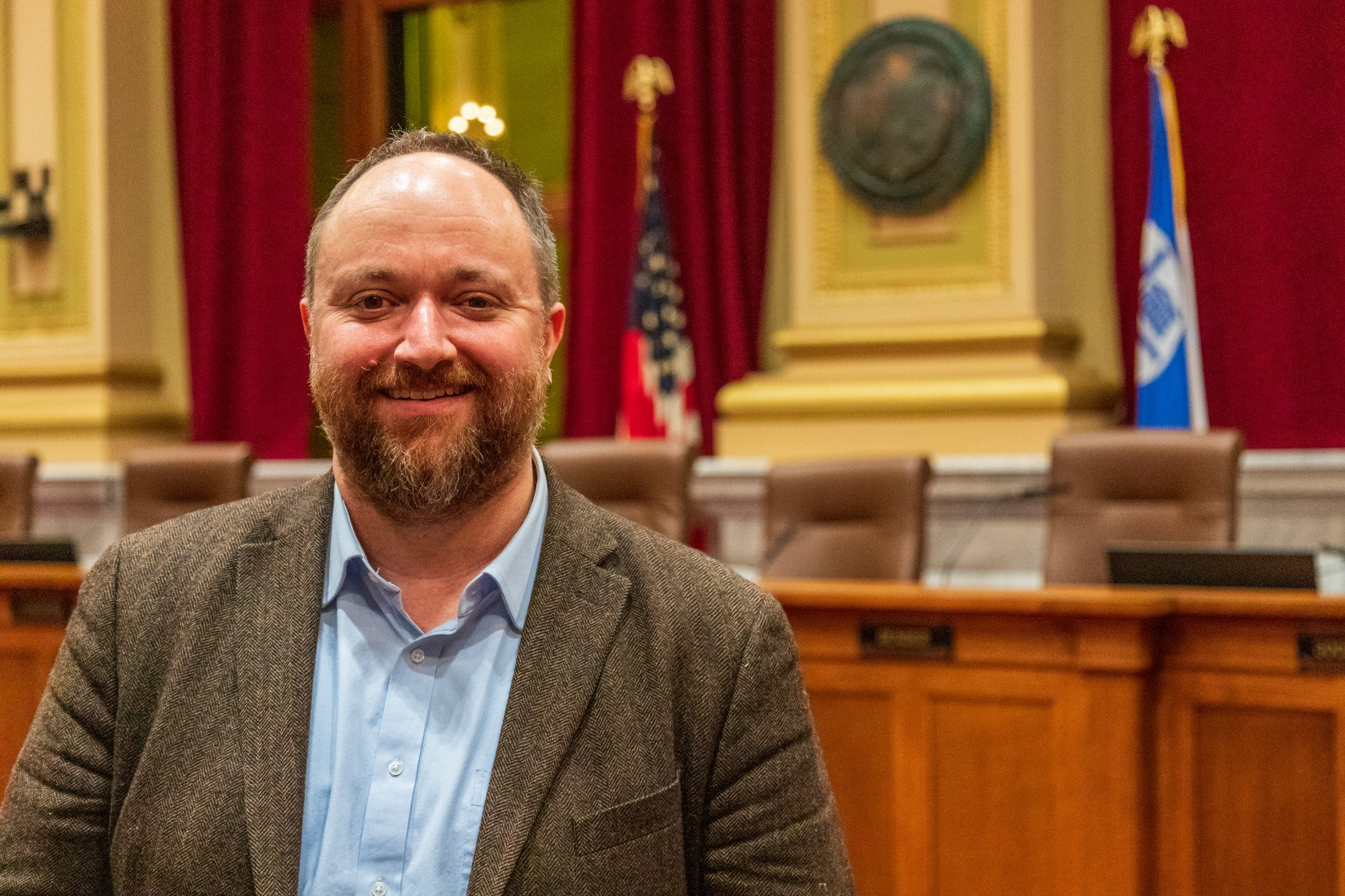 "Minneapolis City Council Member Steve Fletcher poses for a portrait at City Hall on Wednesday, Feb. 5. On data privacy, Fletcher asserts ""We're becoming a smarter and more responsive city, and we're using data to do it. Our residents and visitors deserve to know that we are responsible with their information and respect their privacy – while also keeping our government open and transparent."""