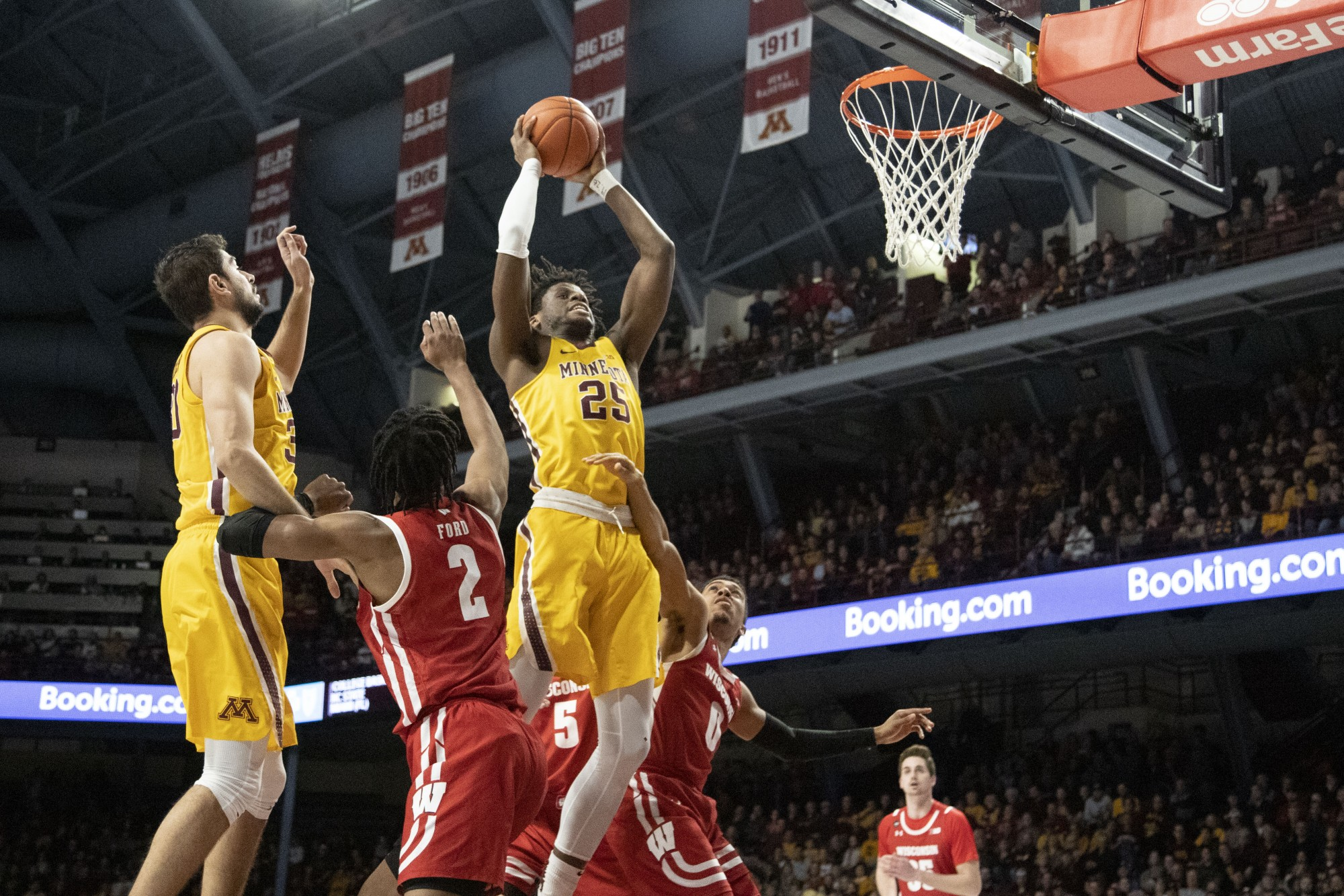 Center Daniel Oturu looks to dunk at Williams Arena on Wednesday, Feb. 5. The Gophers beat the Badgers 70-52.