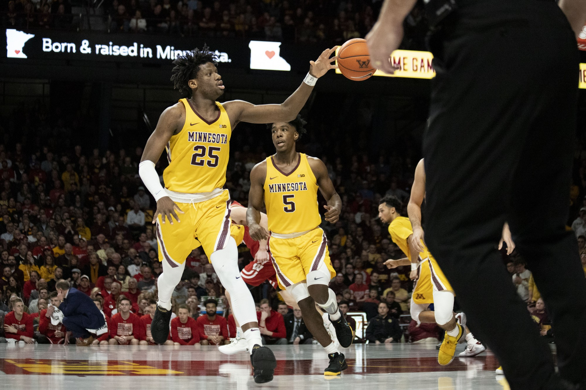 Center Daniel Oturu receives a pass at Williams Arena on Wednesday, Feb. 5. The Gophers beat the Badgers 70-52.