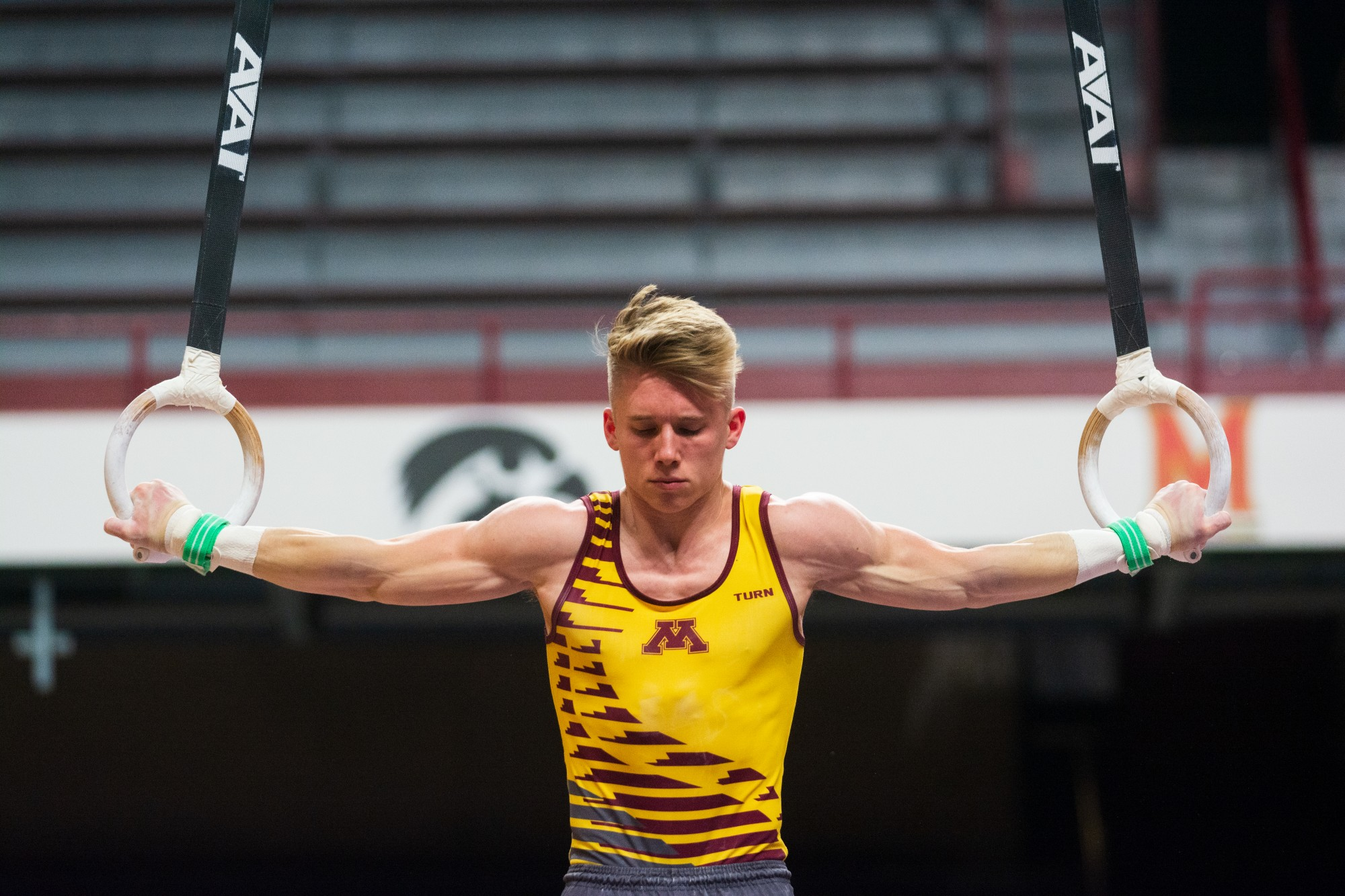 Gophers Junior Shane Wiskus performs a routine on the still rings at Maturi Pavilion on Friday, Feb. 7. The Gophers went on to a 398-375.55 victory over the Washington Huskies.