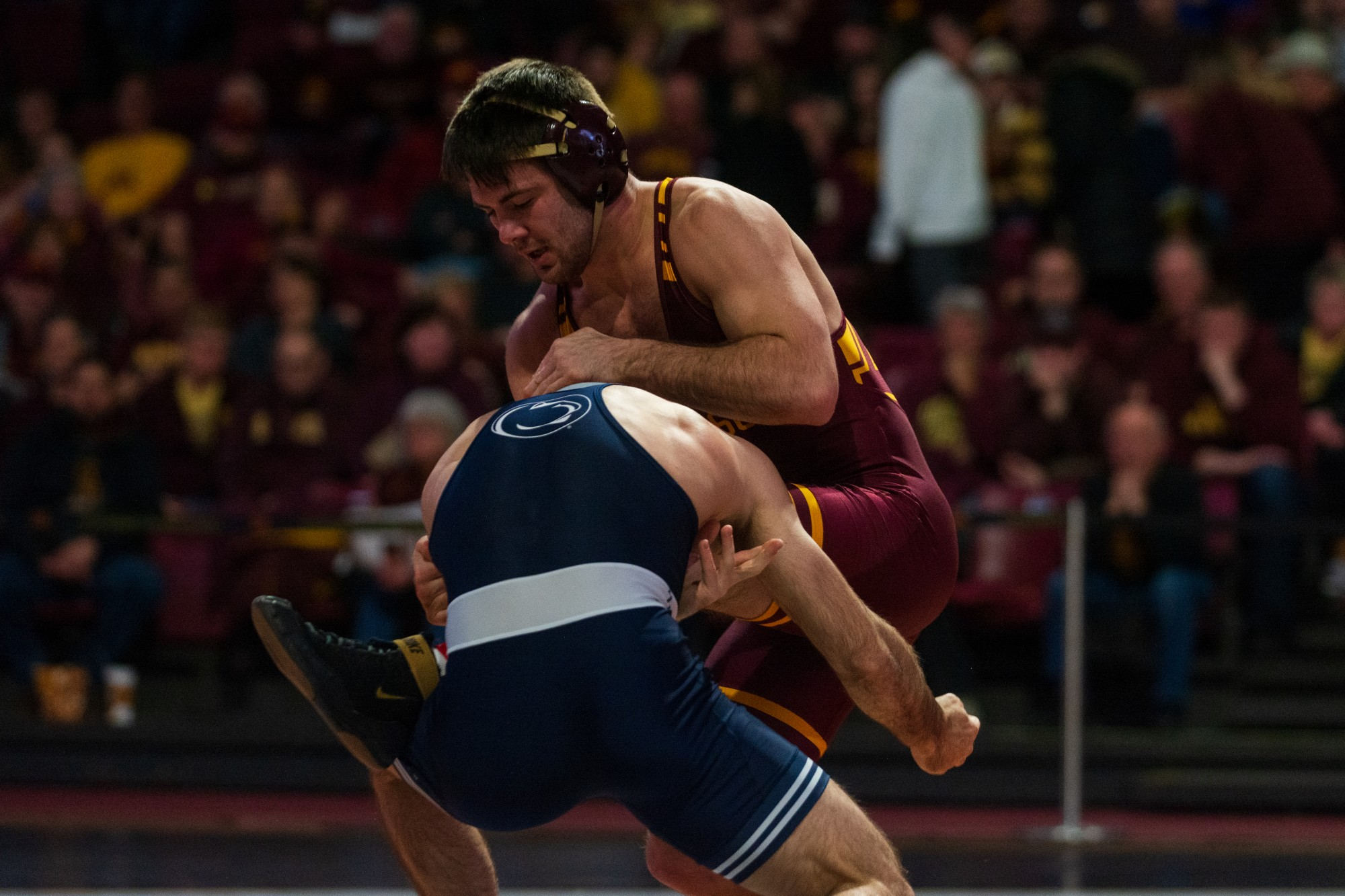 Gophers Brayton Lee fights a takedown at Maturi Pavilion on Sunday, Feb. 9, 2020. The Gophers lost to Penn State 31-10.