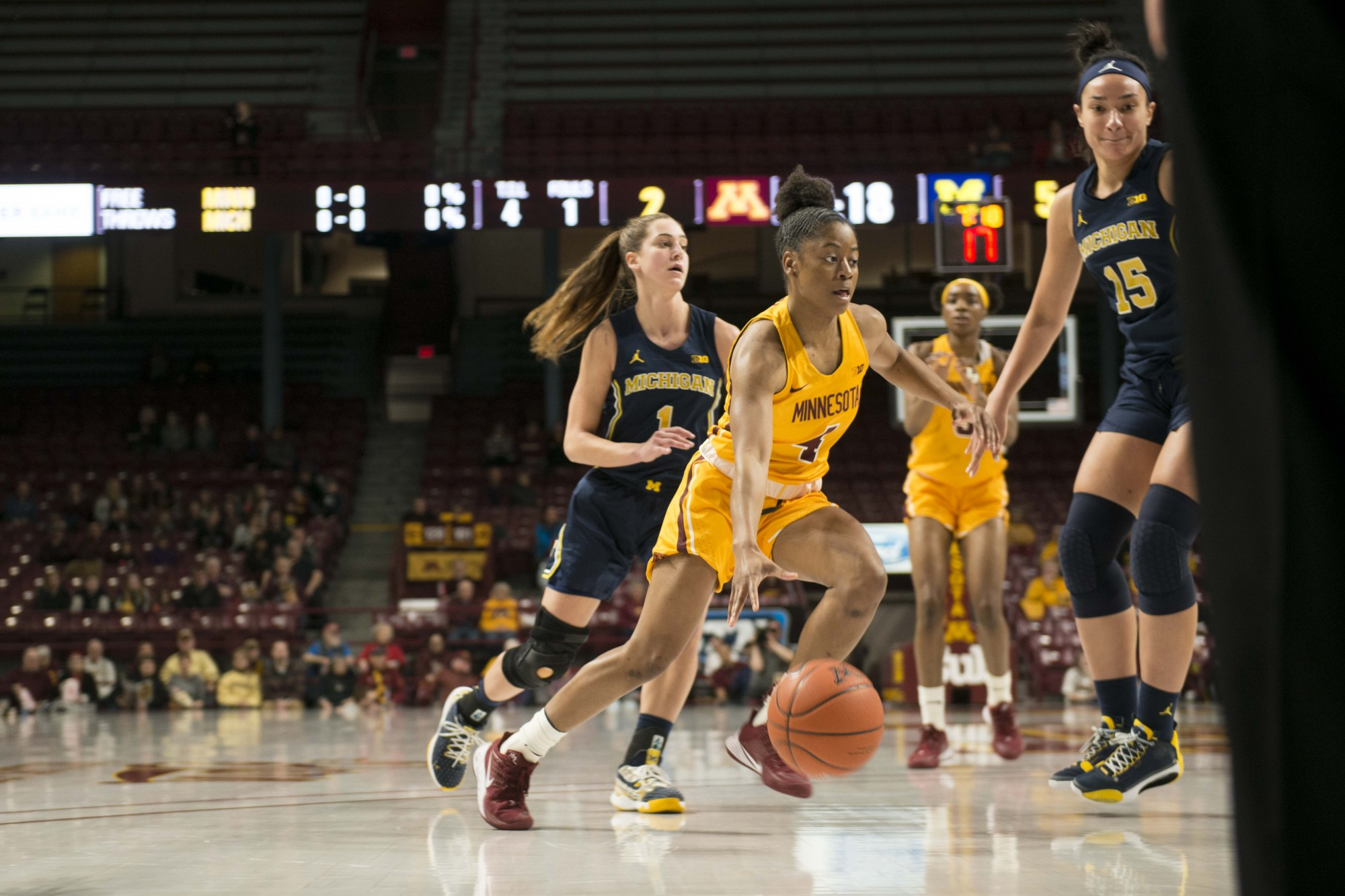 Gopher forward Jasmine Powell approaches defenders in Williams Arena on Sunday, Feb. 10. The Gophers suffered a defeat against Michigan 52-77.
