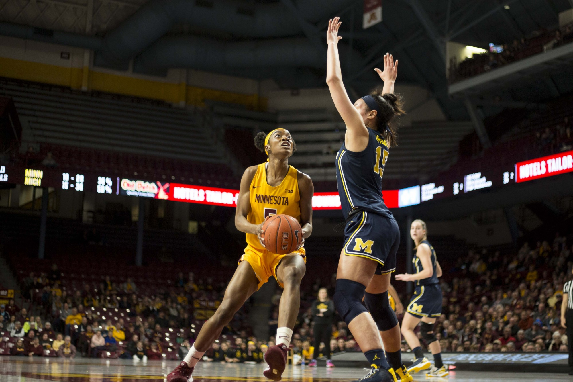 Gopher forward Taiye Bello squares up for a basket in William's Arena on Sunday, Feb. 10. The Gophers suffered a defeat against Michigan 52-77.