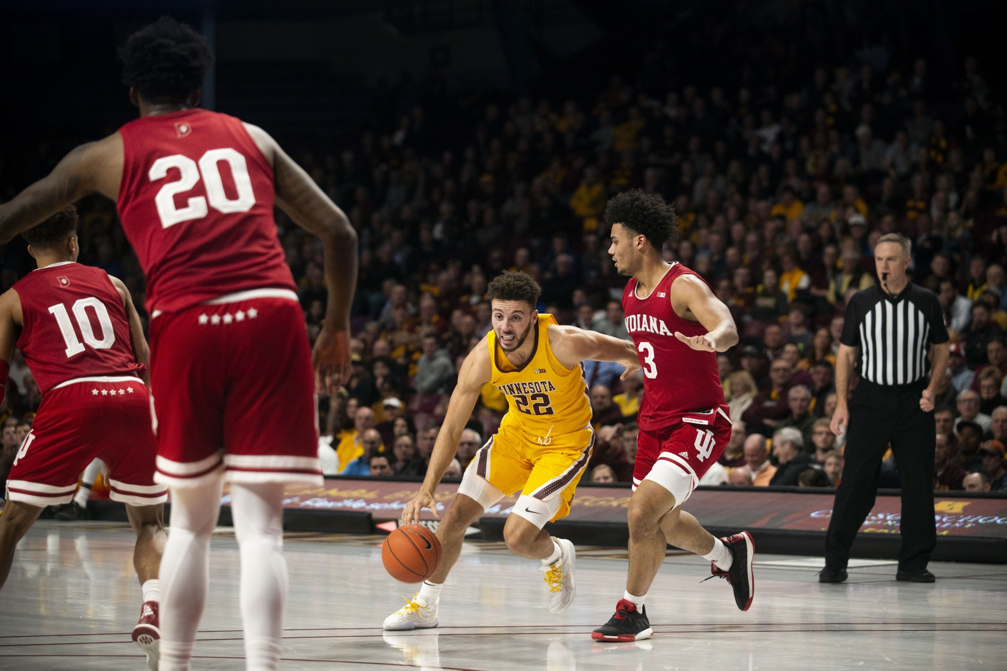 Guard Gabe Kalscheur drives the ball through the defenders at Williams Arena on Wednesday, Feb. 19.
